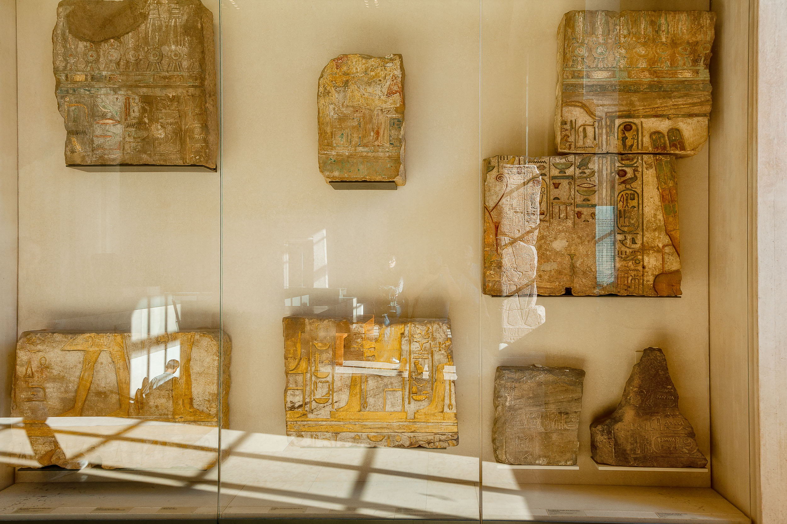 A display case showcasing  stone tablets  at the  Louvre  in  Paris, France .