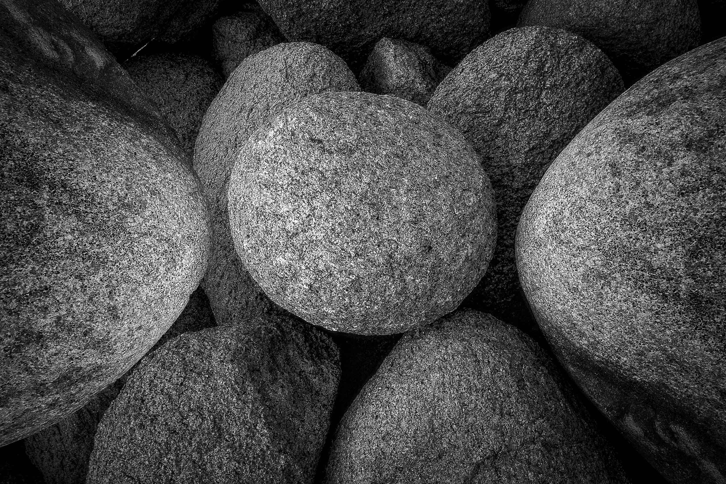 Stones , rounded by waves and wind, on the beach at  Cape Woolamai  on  Phillip Island, Australia .