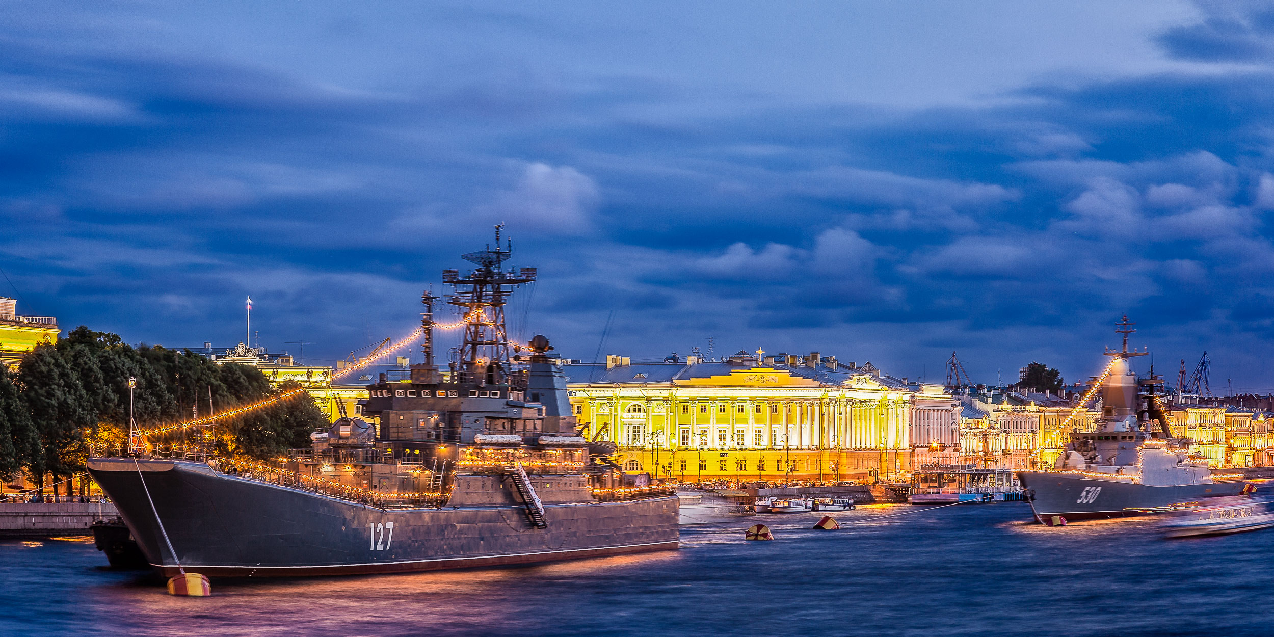 Battle ships  cruise up to the  Palace Bridge  on the  River Neva  on a warm summer night in beautiful  St. Petersburg, Russia