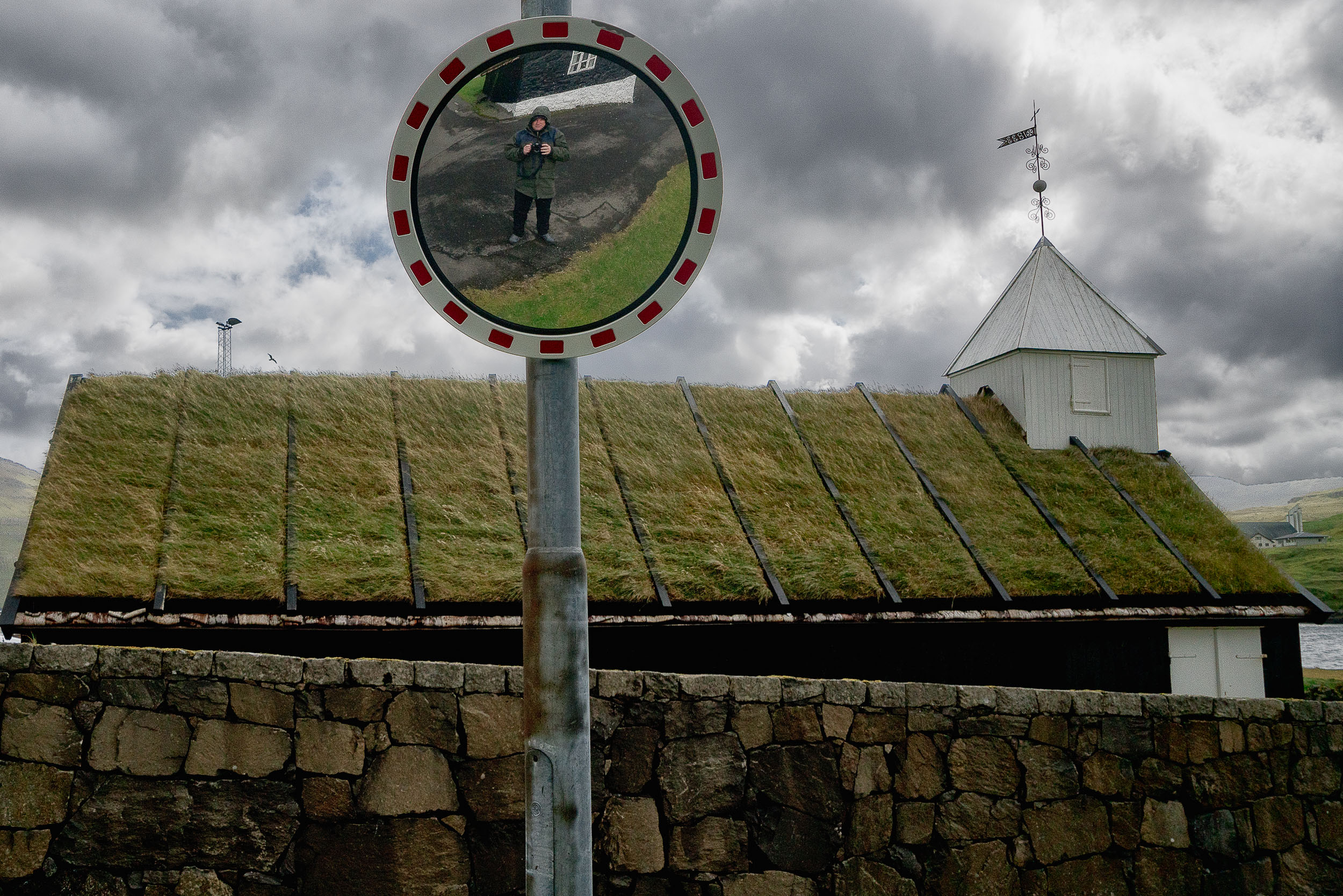 A    self portrait    of    Glenn Guy, the Travel Photography Guru   , in the village of    Nordragota    in the    Faroe Islands   .