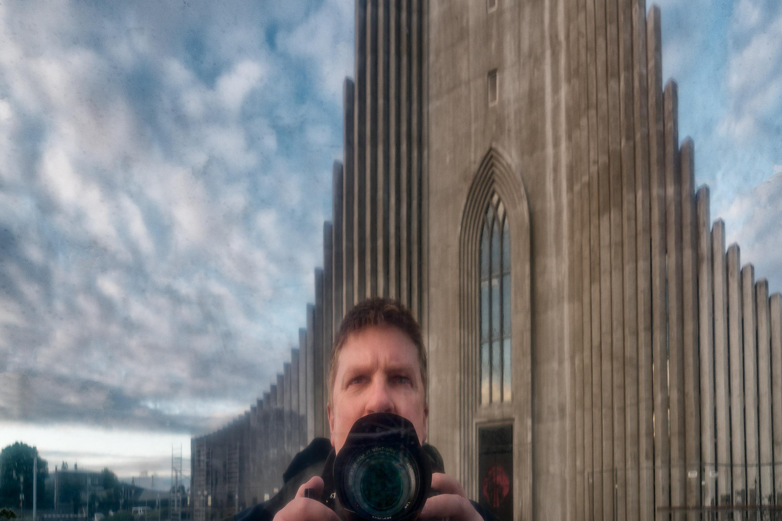 A    self portrait    of    Glenn Guy, the Travel Photography Guru   , outside    Hallgrimskirkja Luthern church    in    Reykjavík, Iceland   .