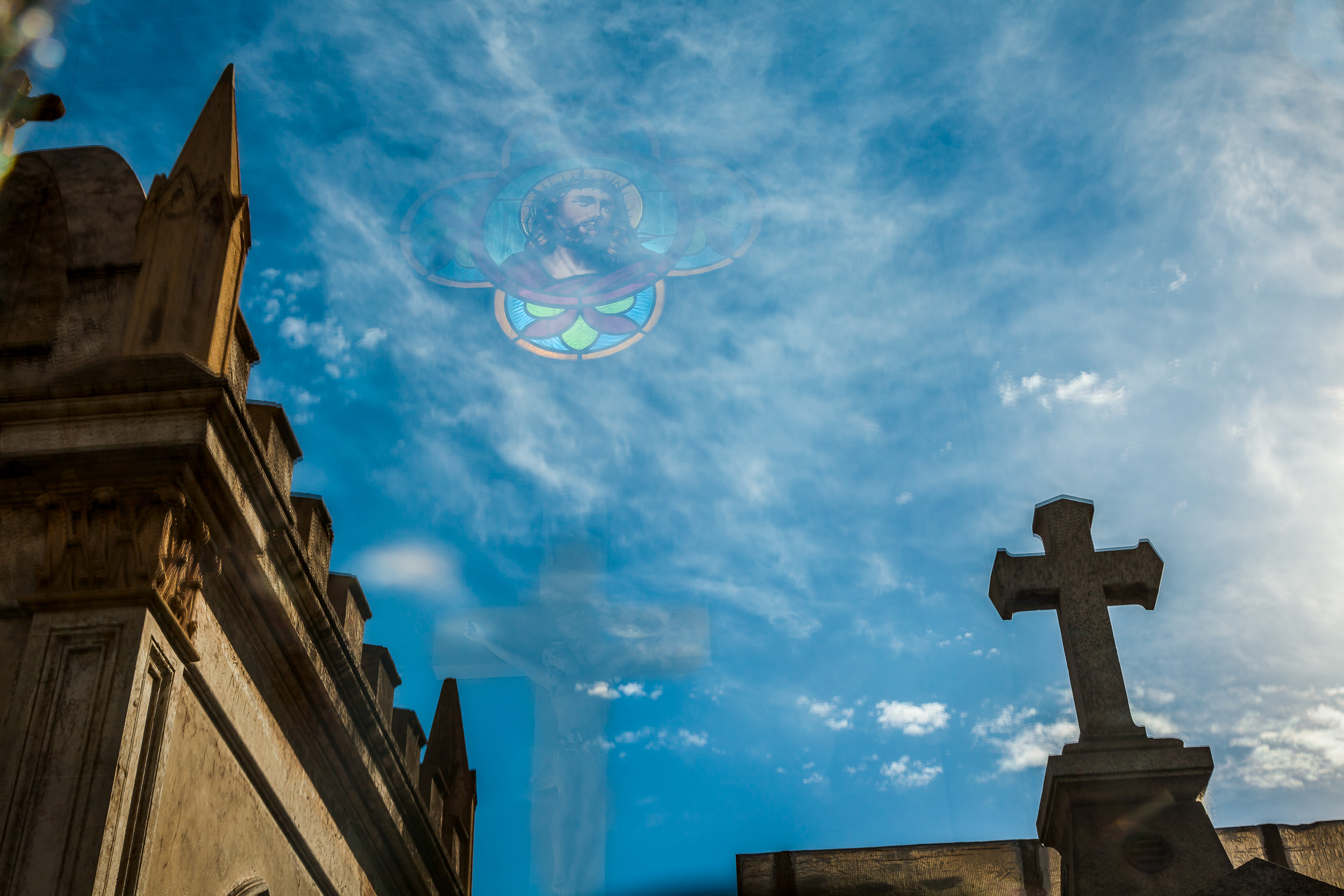 A very    surreal photo    that, via reflection,    displays the face of Jesus in the sky    above the magnificent    La Recoleta Cemetery    in    Buenos Aires, Argentina   .
