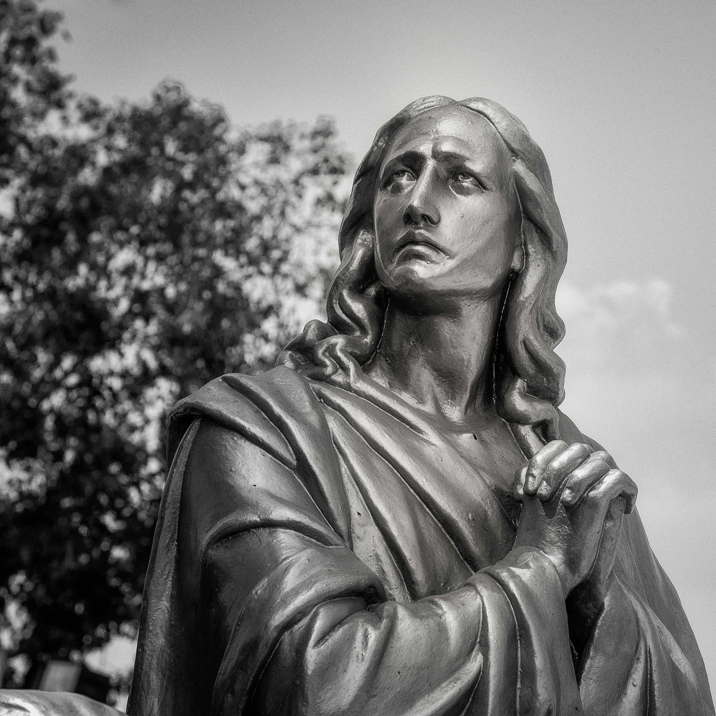 A lovely    statue   , photographed in    black and white   , on    St. Thomas Mount    on the outskirts of    Chennai in India   .