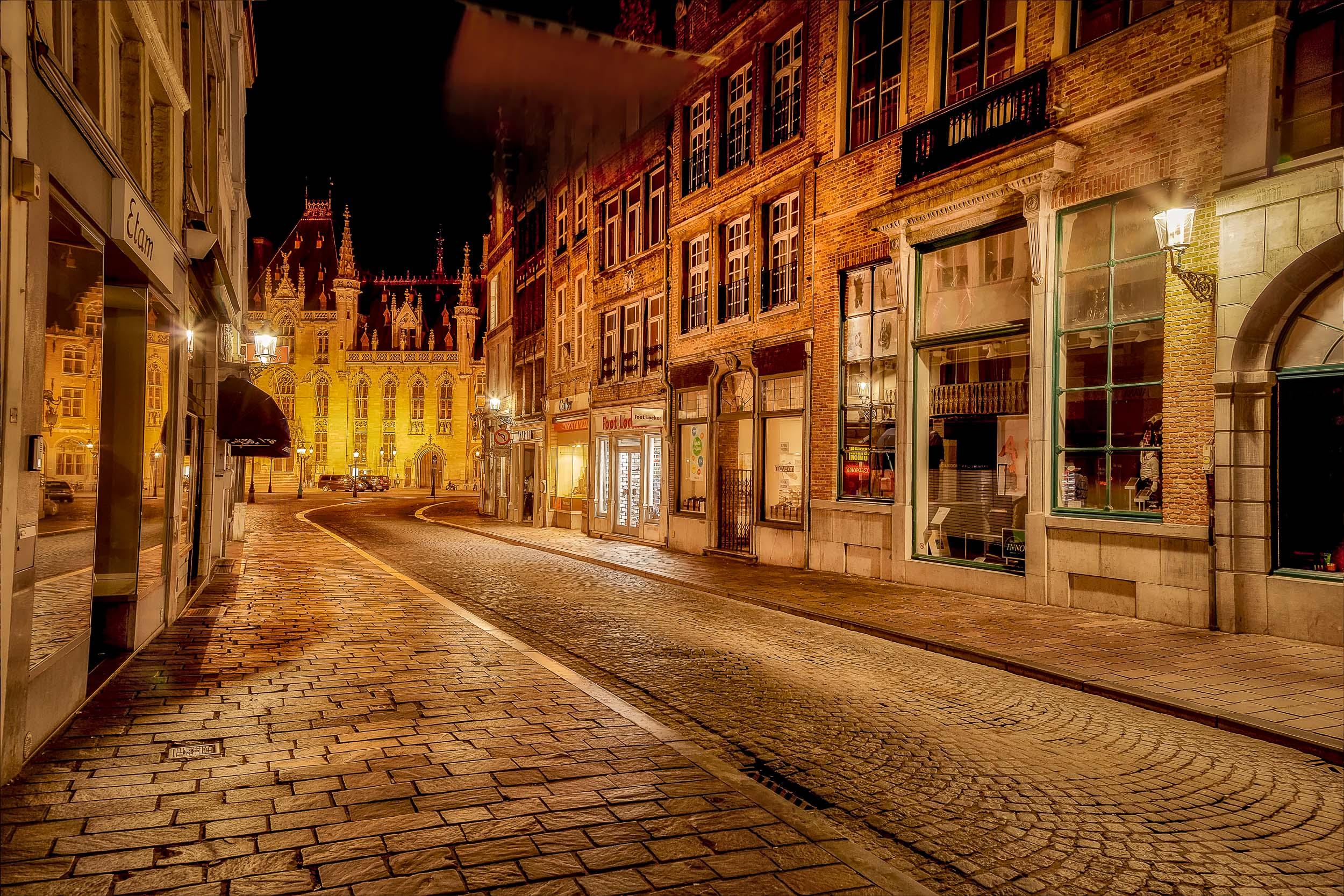 Cobbled street in Bruges (i.e., Brugge), Belgium after a summer rain shower.