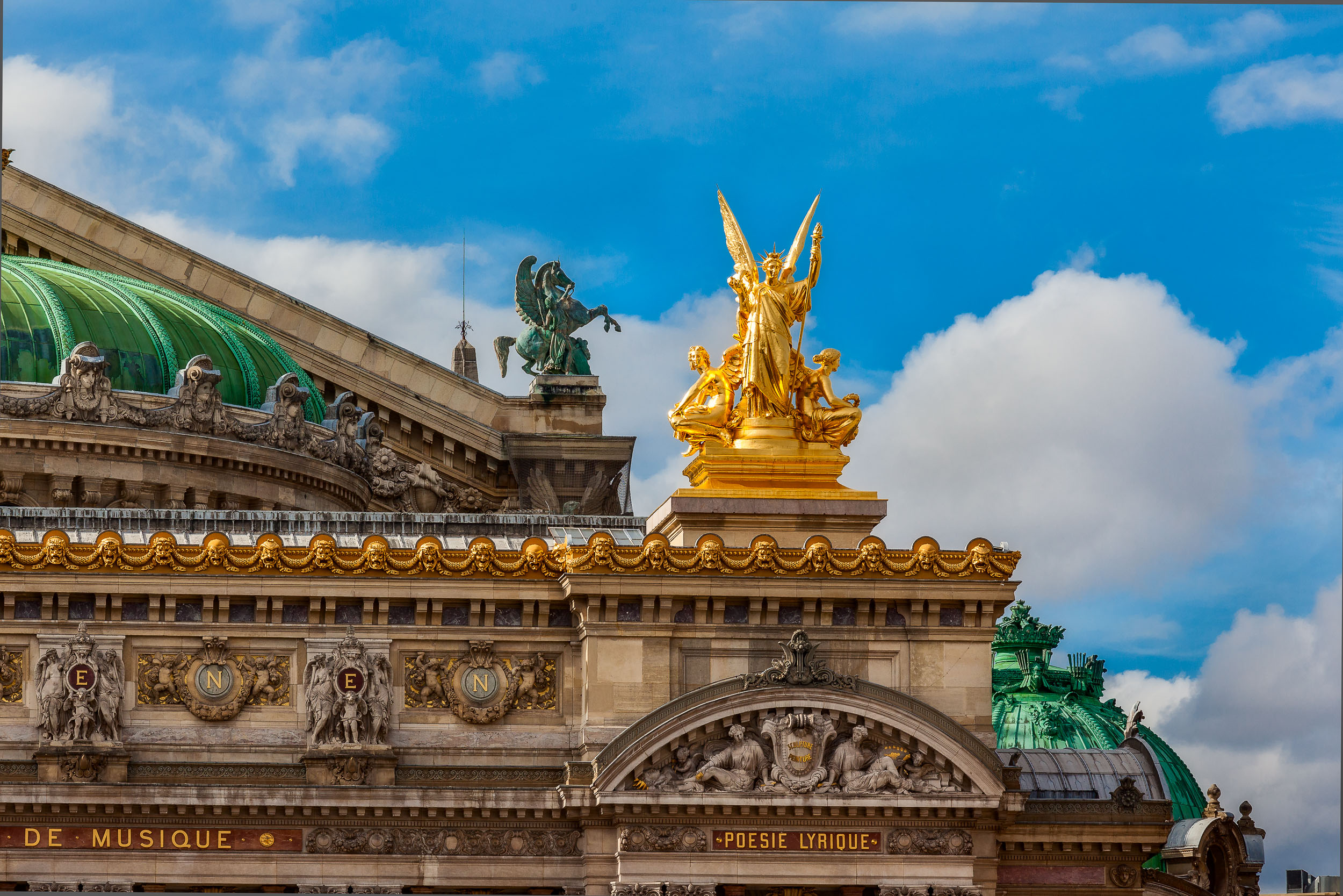 A golden angel atop the Académie de Poésie et de Musique in Paris, France