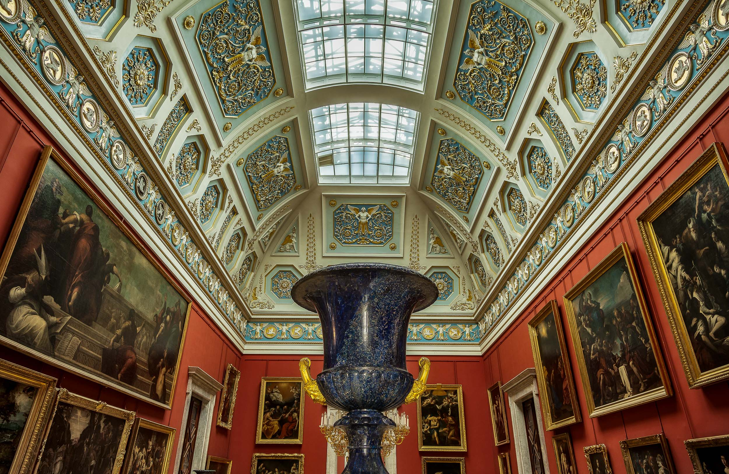 A highly structured interior view of a gallery within the Hermitage Museum in St. Petersburg, Russia .