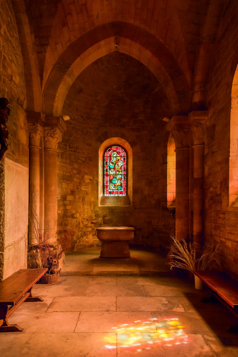 A    quiet moment    in a    chapel in Paris, France   . This image employs light, shape and color to explore mood.