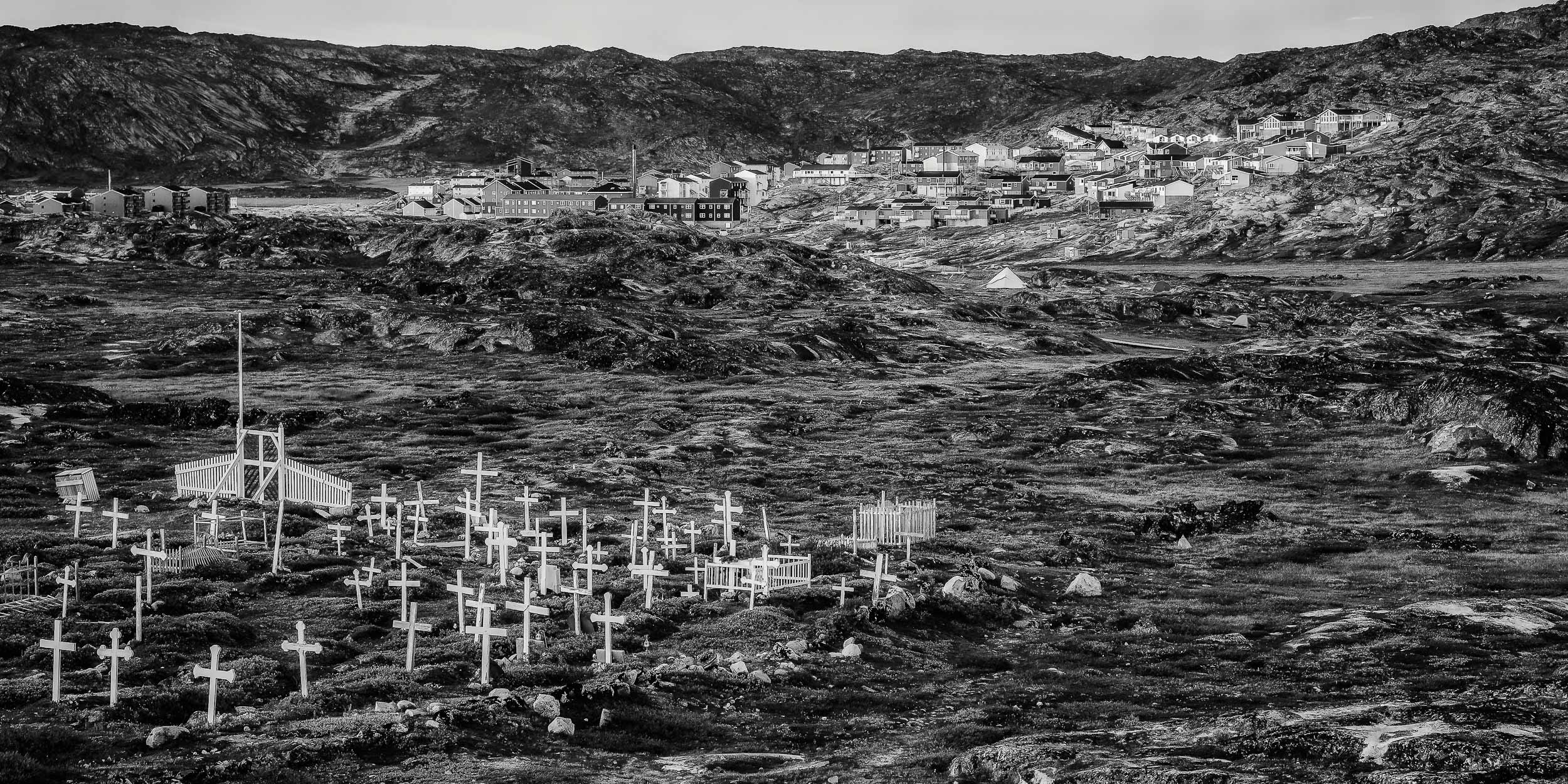 A    late evening    view of the    cemetery and town outskirts    at    Ilulissat, Greenland