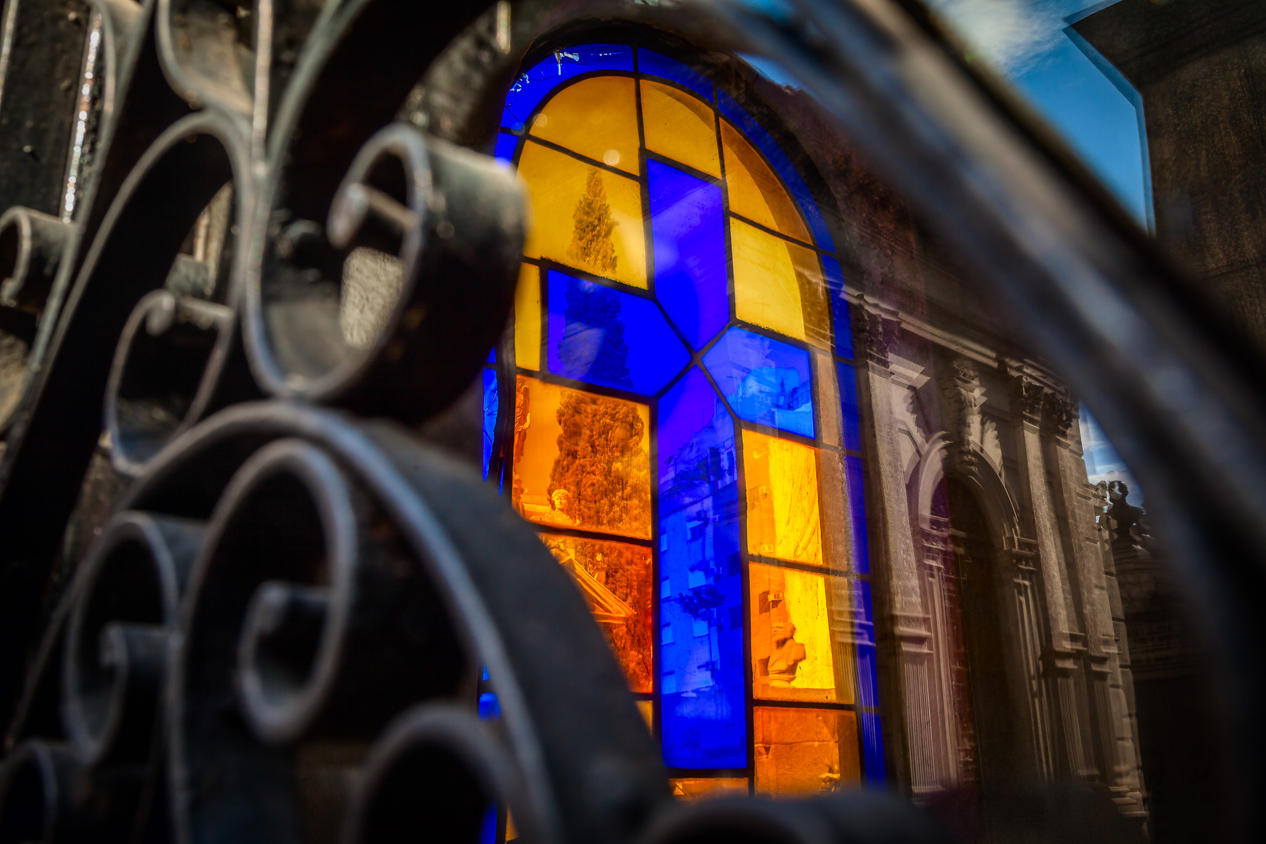 A    dramatic and surreal photo    that explores the notions of here and there, and day and night, at    La Recoleta Cemetery, Buenos Aires, Argentina   .
