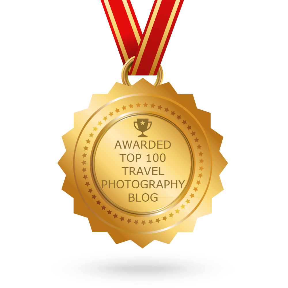 Logo illustrating that    www.travelphotographyguru.com   has been awarded a    Top 100 Travel Photography Blog   by    Feedspot   .