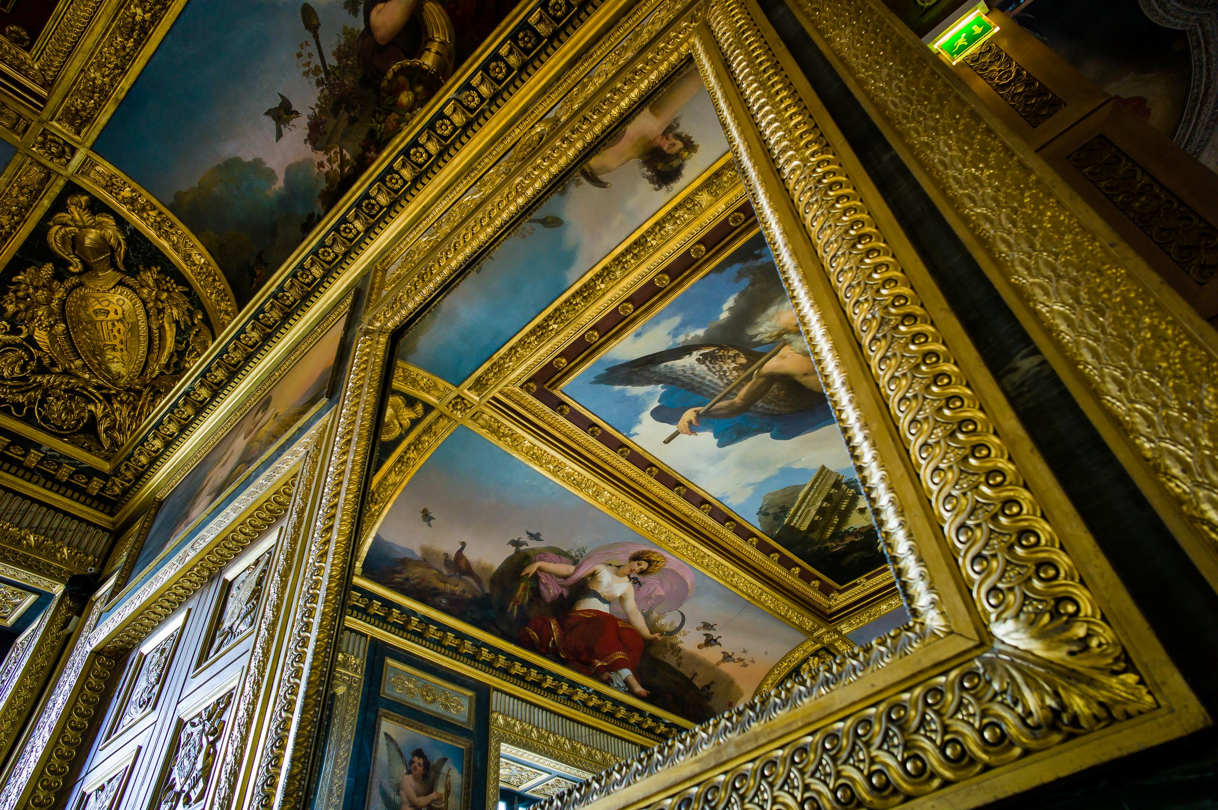 Artwork    reflected in    mirrors    at the    Louvre    in    Paris, France   .