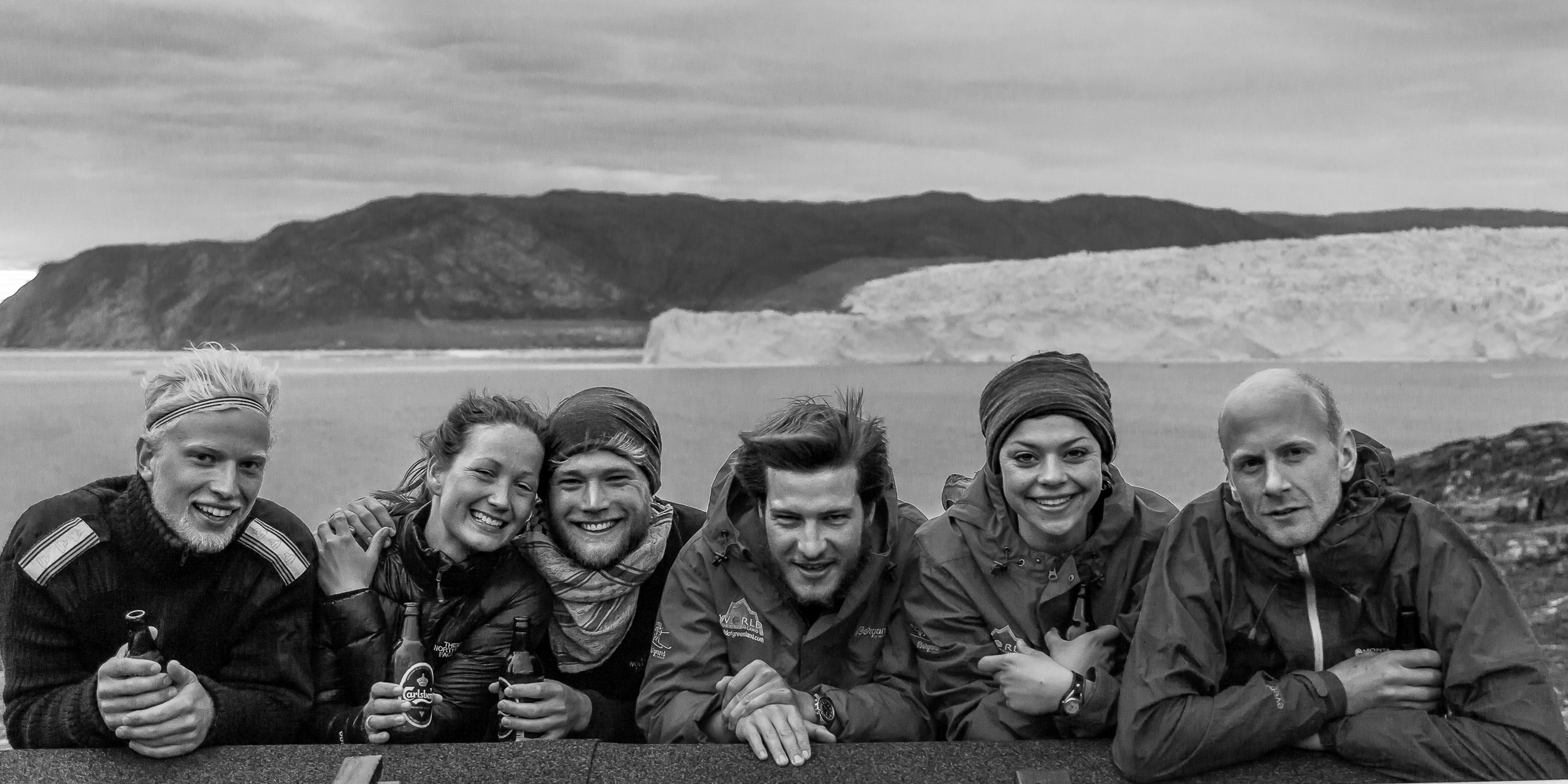 A  group portrait  of friends at the fantastic  Ice Camp Eqi  in  Greenland  with the  Eqi Glacier  in the background.