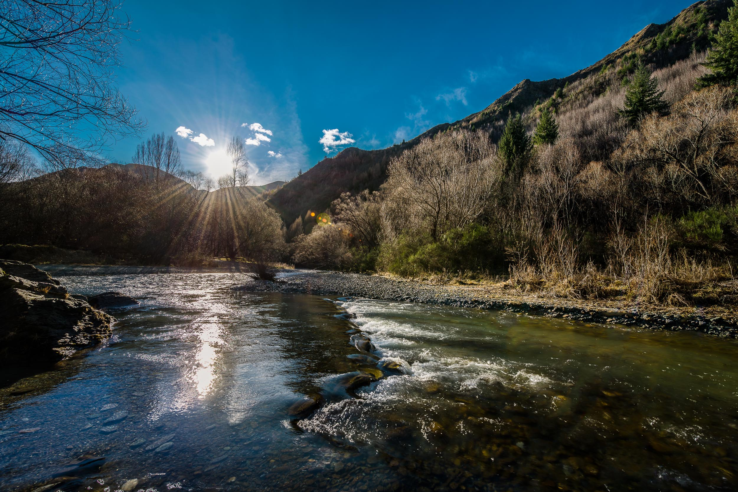 A view of the picturesque    Arrow River    on a    winter's day    in    Arrowtown    on the South Island of    New Zealand   .