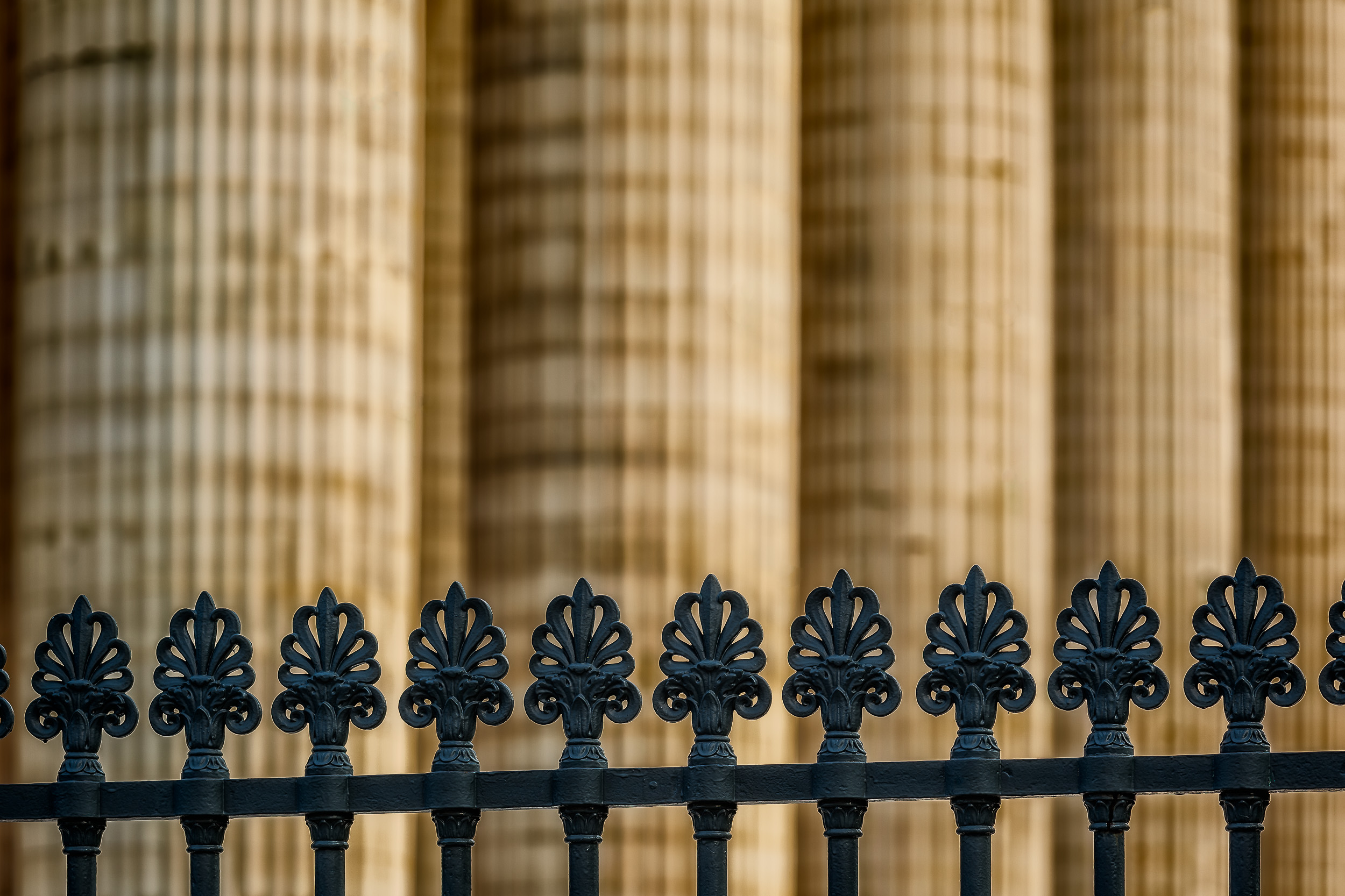 A  fence line , marking a boundary between the pavement and an historically important structure becomes an important  element of composition  in this image of the  Pantheon  in  Paris, France .