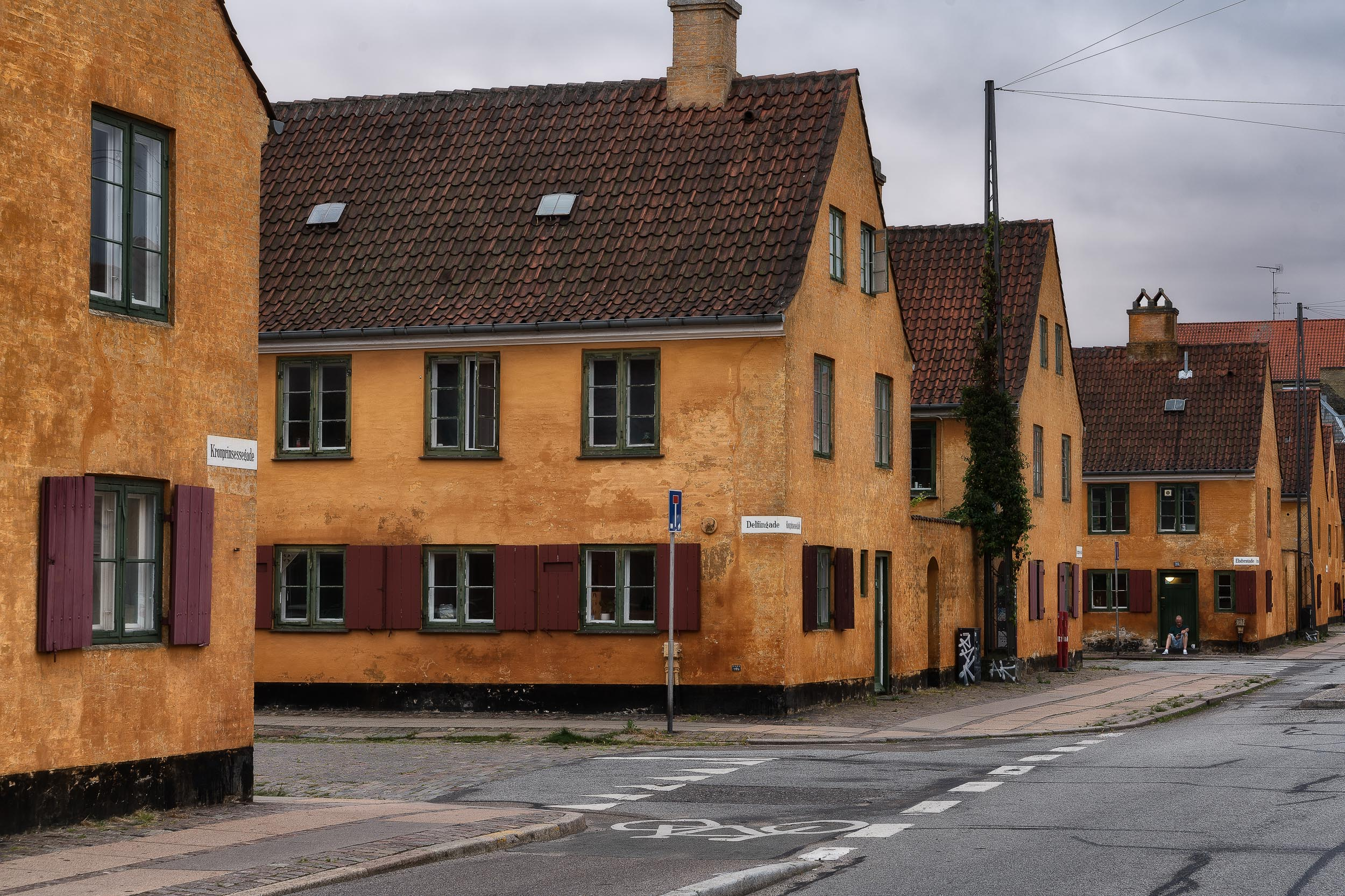 Parallel running streets of    orange painted housing    in    Copenhagen, Denmark   .