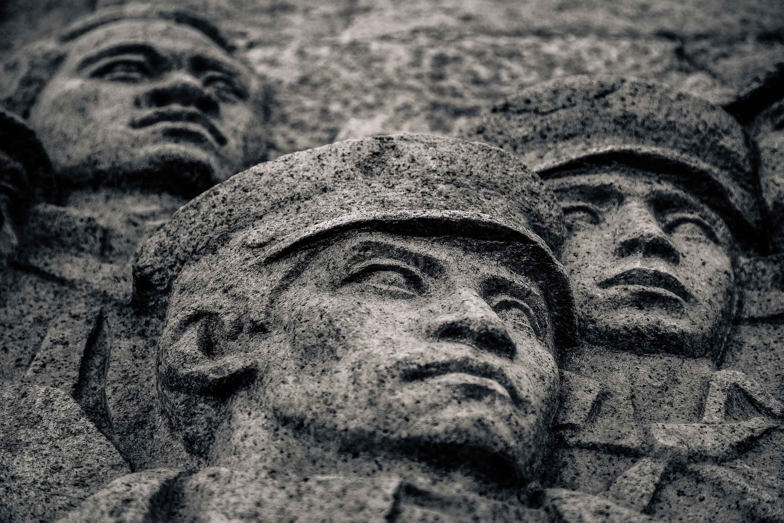 Soldiers faces, carved into stone along    The Bund    in    Shanghai   , China. The Bund is one of many great opportunities photographing China opens to you.