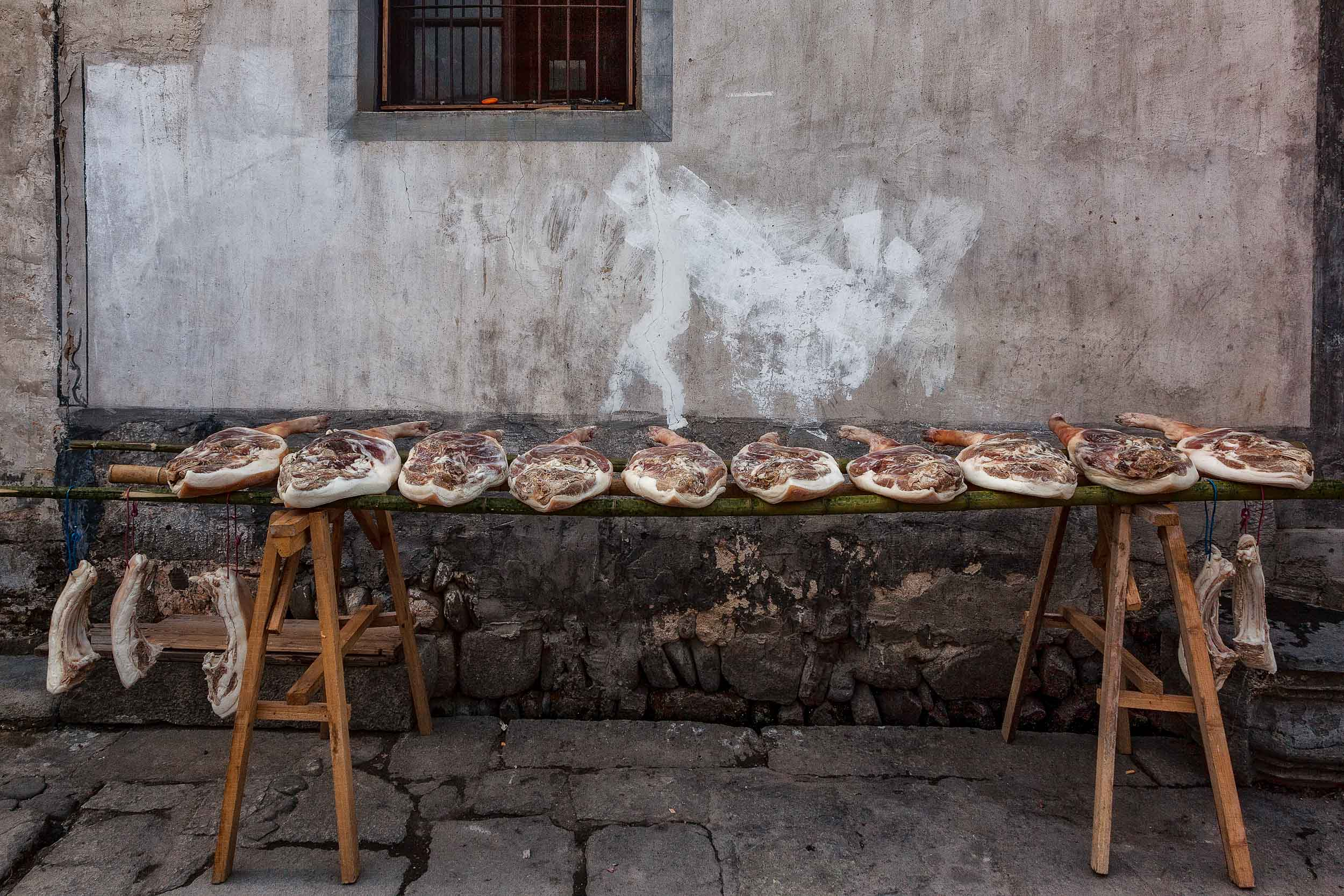 A detailed image of goods for sale in a    local butcher shop    in the traditional village of    Hongcun, China   . One of many curious sights you can find photographing China.