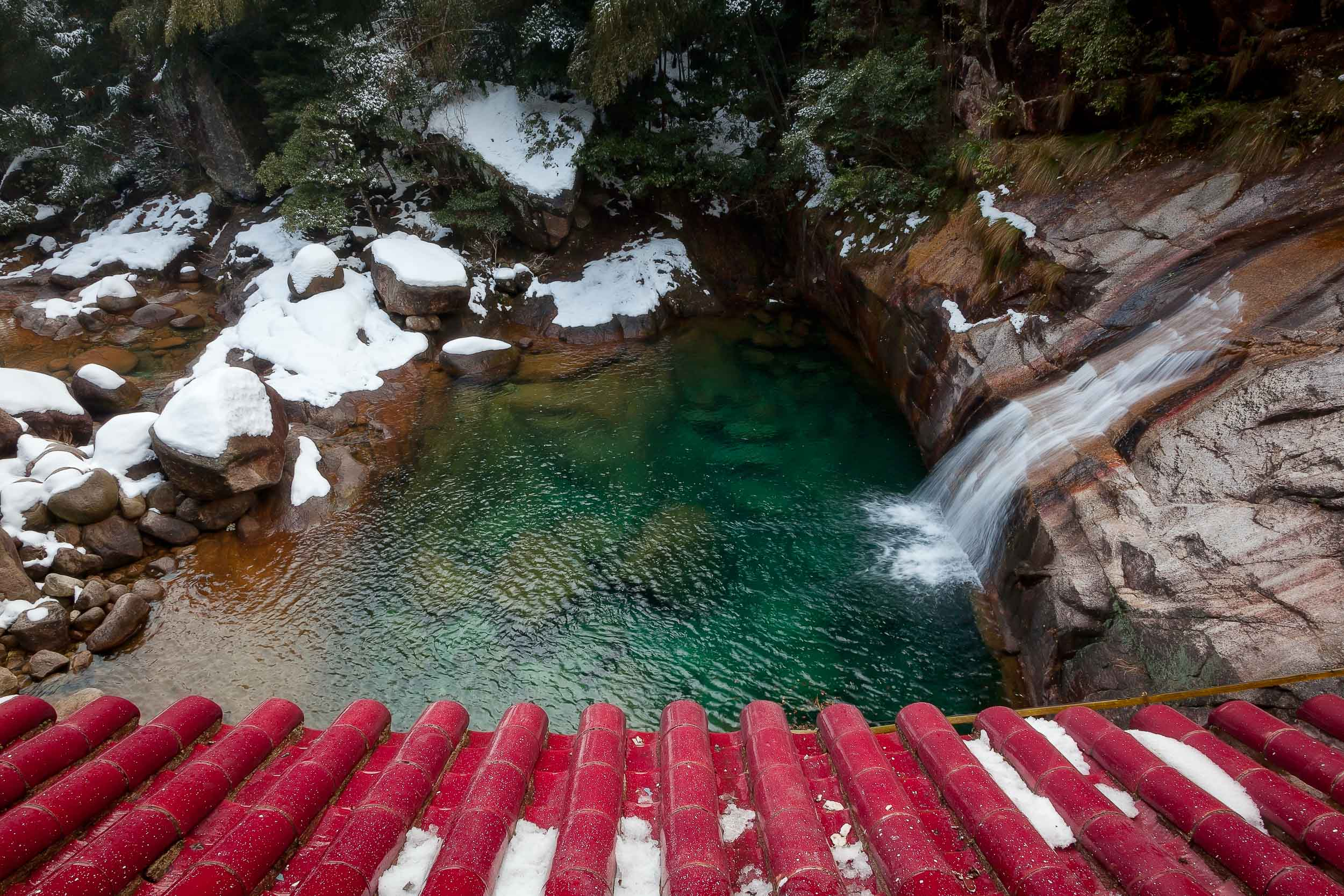 My own China holidays have involved many sublime moments such as when I made this  colorful photograph of a  pagoda rooftop  and tranquil pool fed by a small waterfall near  Huangshan, China .