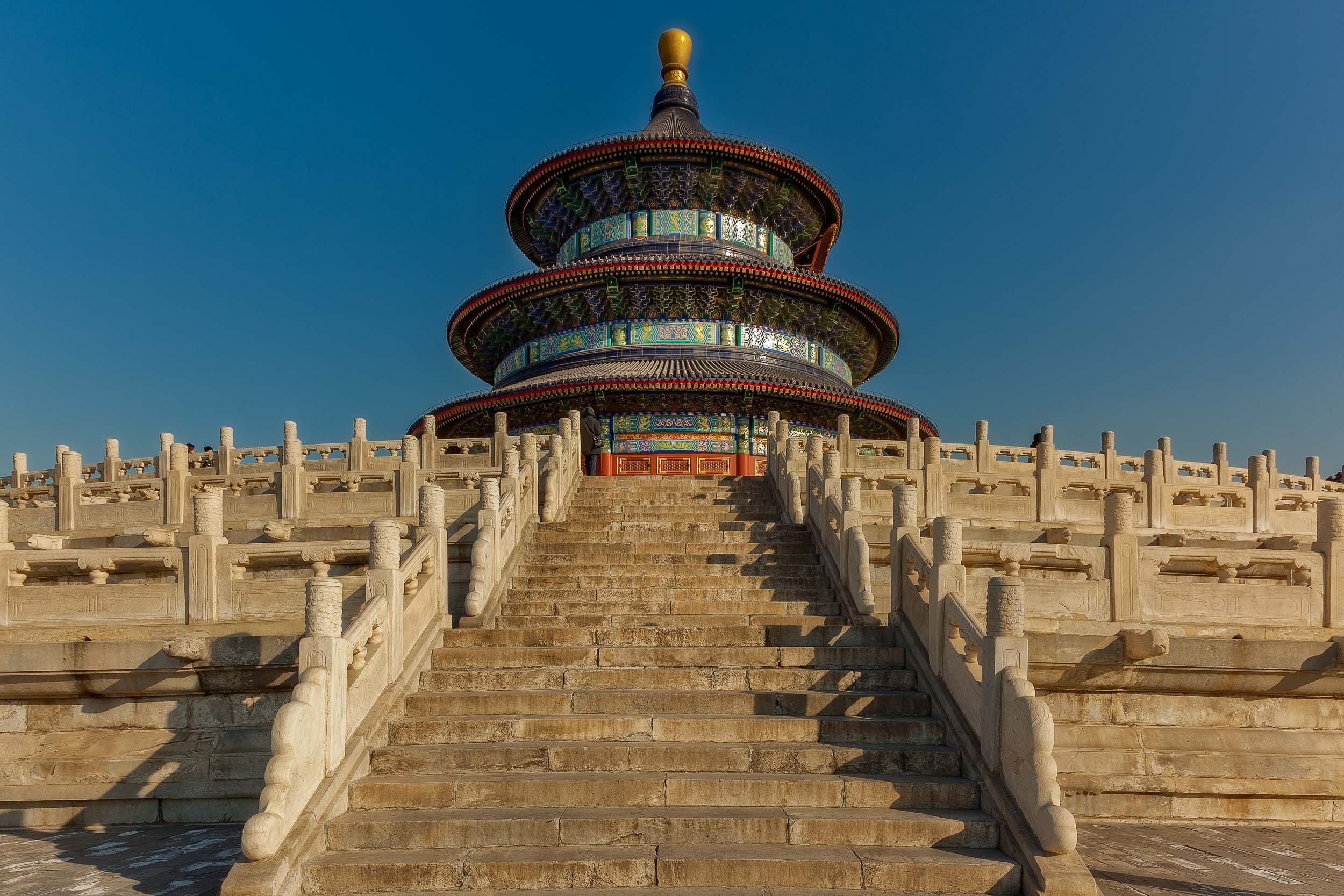 A view up a flight of stairs to a beautiful architecutral structure in the grounds of the    Temple Of Heaven    in    Beijing, China   . As you can see photographing China can include beautiful, blue skies.
