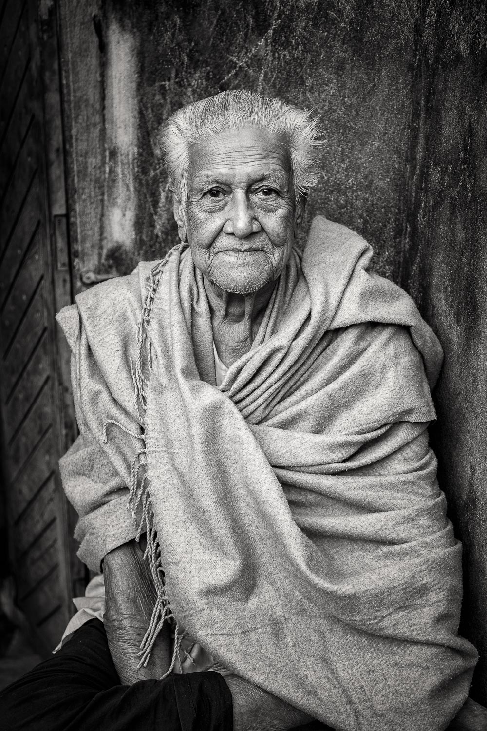 A dignified black and white  portrait of a gentle soul  in  Kolkata, India .