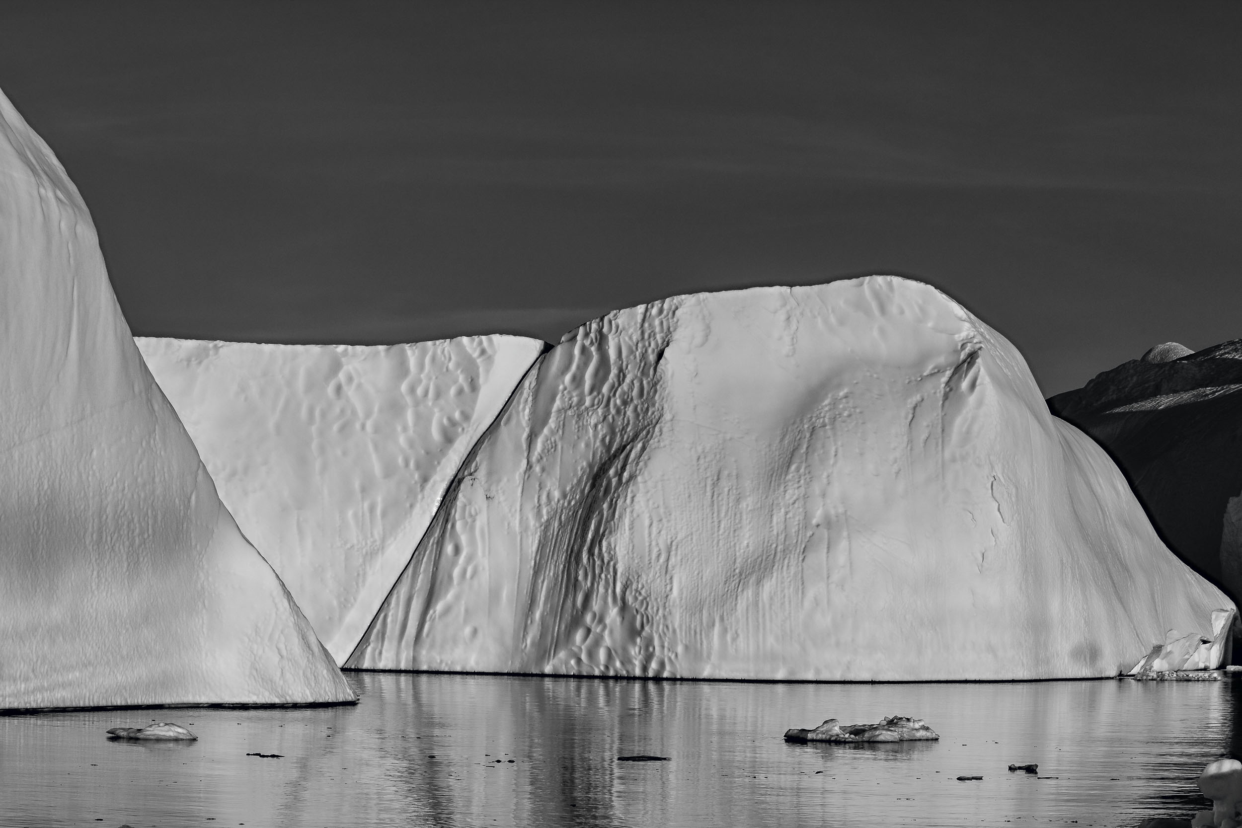 I was drawn to this interesting    triangular shape    in the middle of this    collision of icebergs    on the    Ilulissat Icefjord    in    Greenland   .