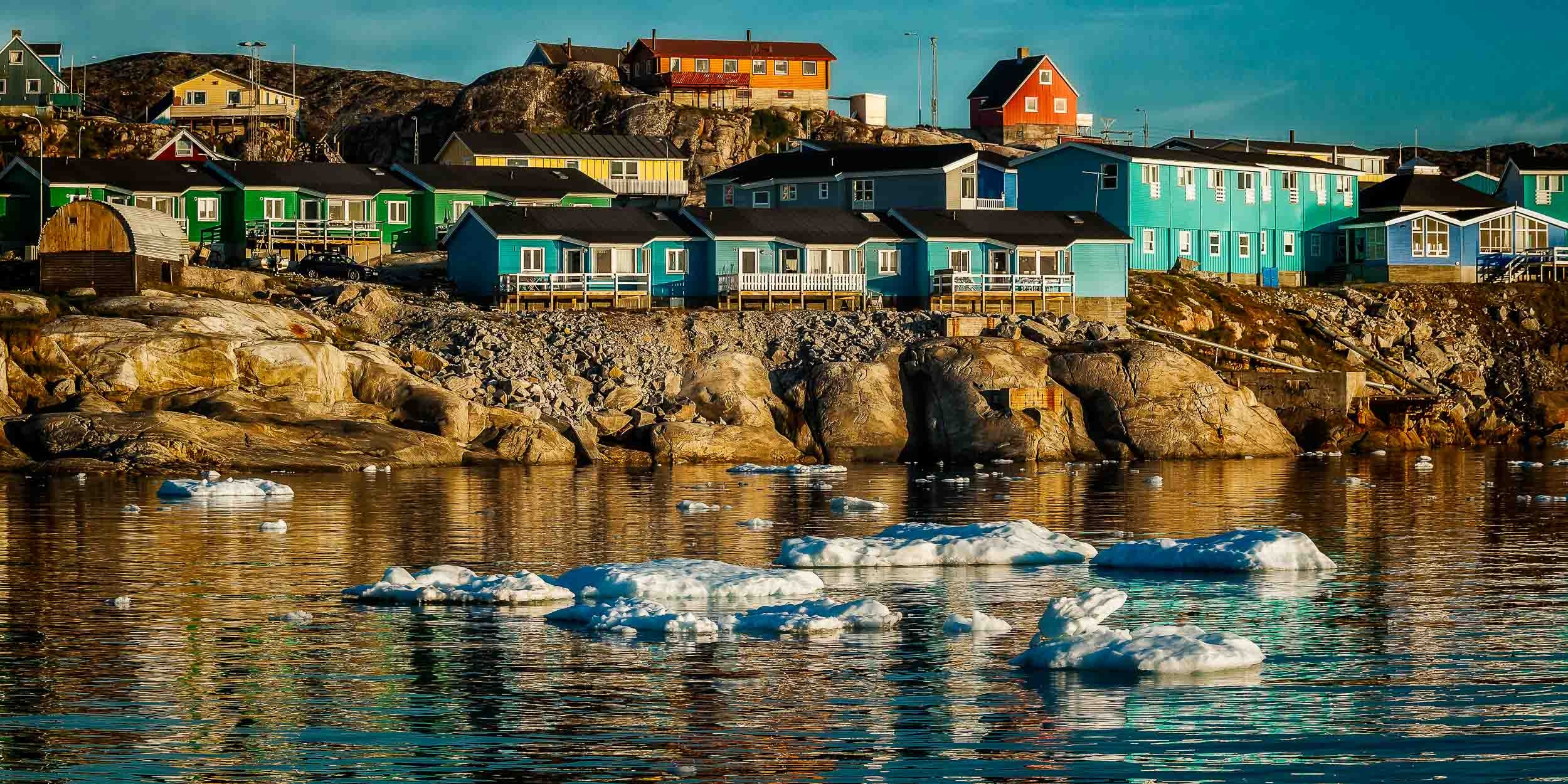 Colorful accommodation  overlooking the waters of the  Ilulissat Icefjord  in  Ilulissat, Greenland .
