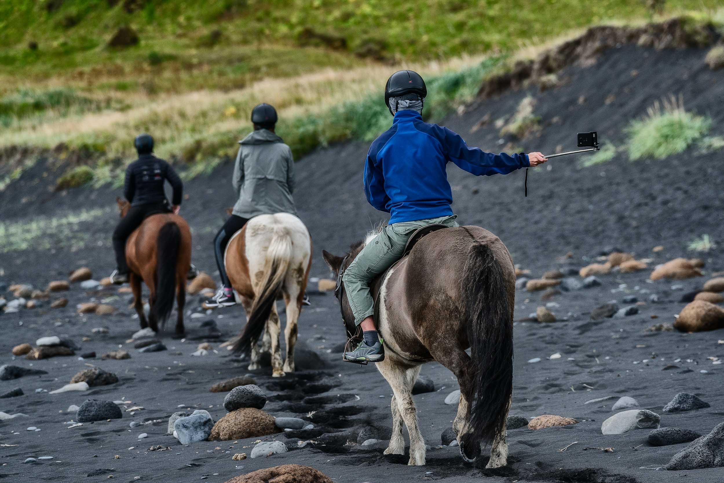 I'd composed what I thought was a good photo of    three horse riders    on the black sand beach of    Reynisfjara near Vik    in south eastern    Iceland   . Just as I was about to make the photo one of the riders brought out the selfie stick, which changed the narrative and enhanced the story being told.