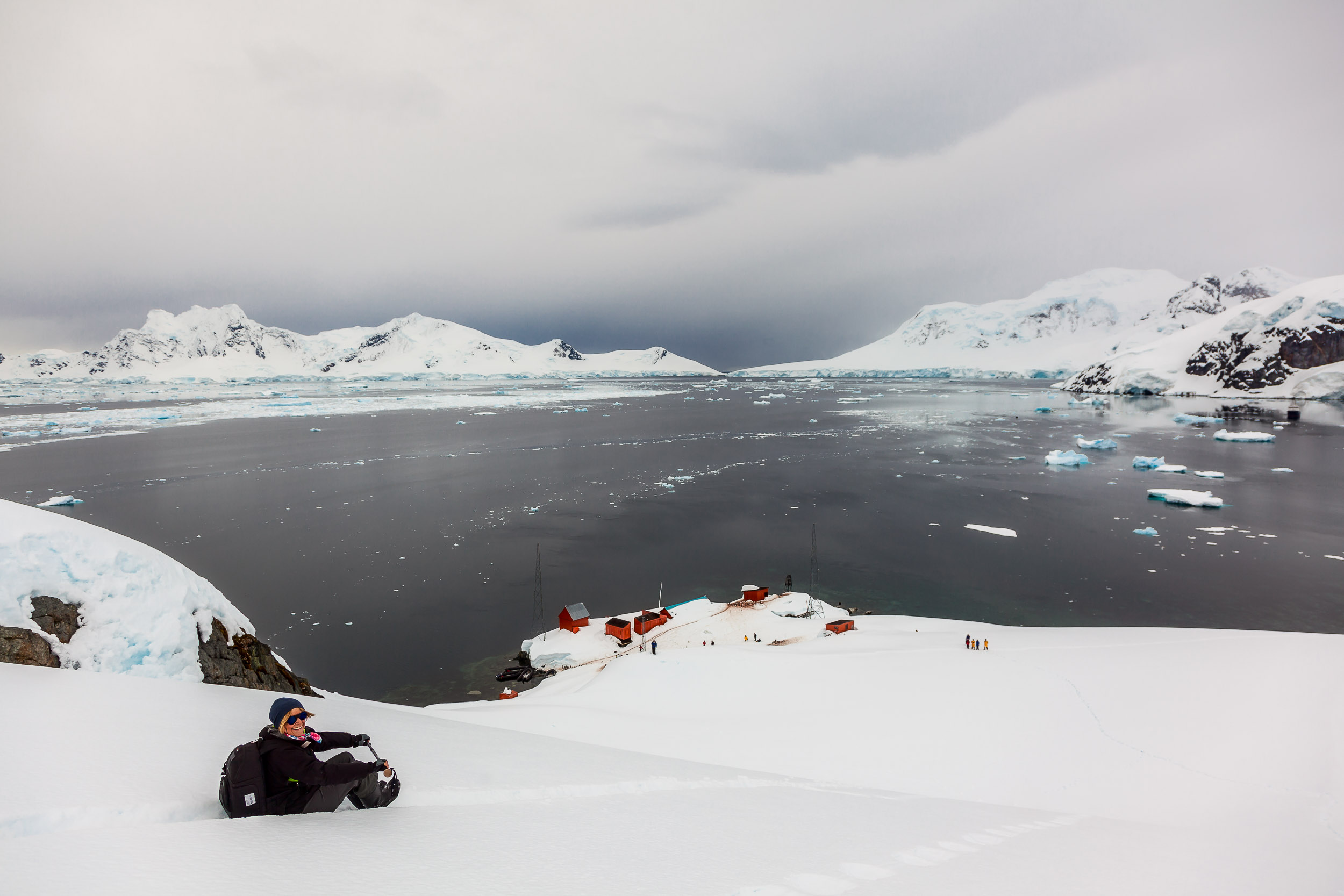 After making the arduous climb    up the hill    overlooking    Paradise Harbour in Antarctica   , it's an absolute thrill to slide down, in a fraction of the time.