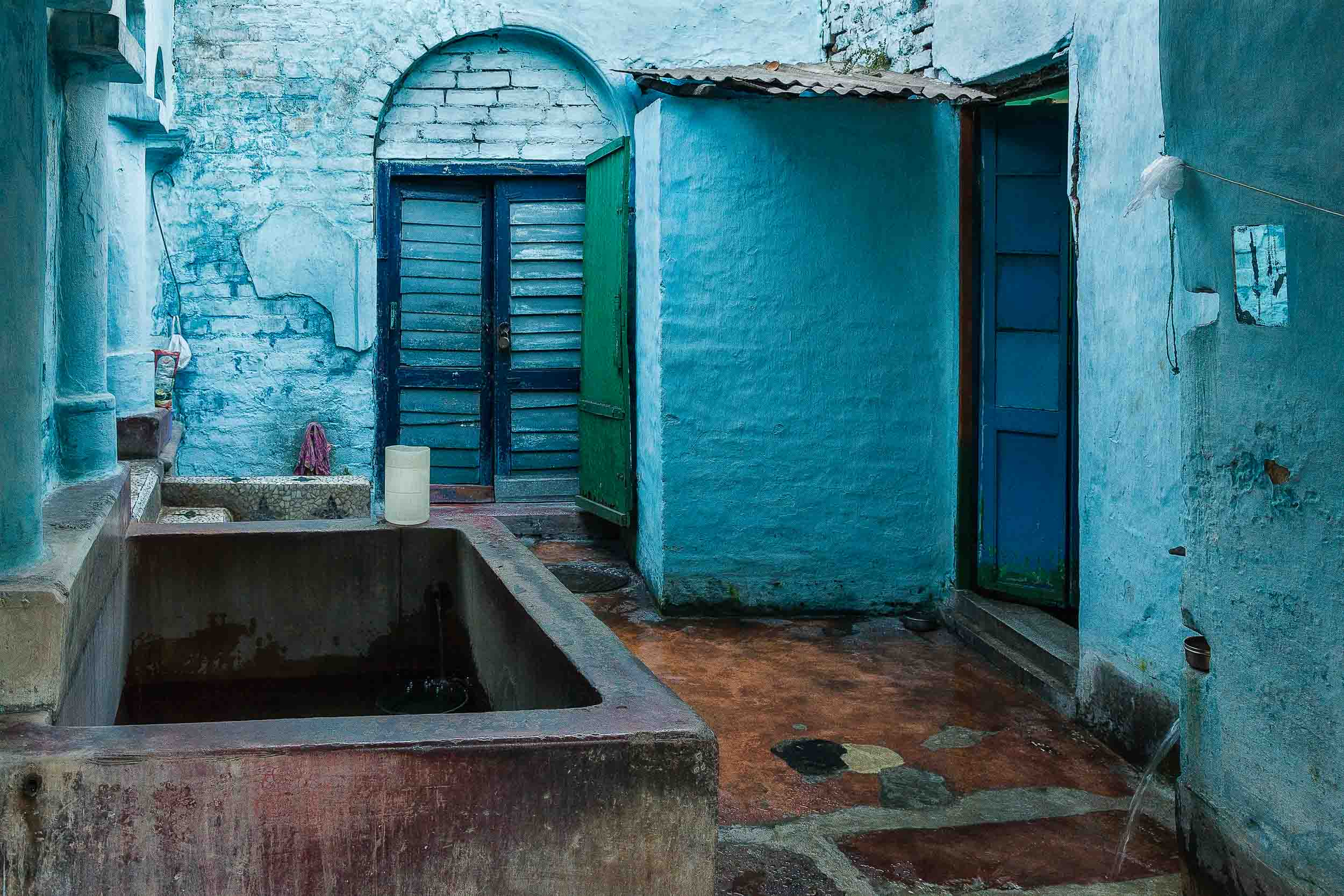 The colors    blue and aqua    dominate this    household courtyard    in    Kolkata, India   .