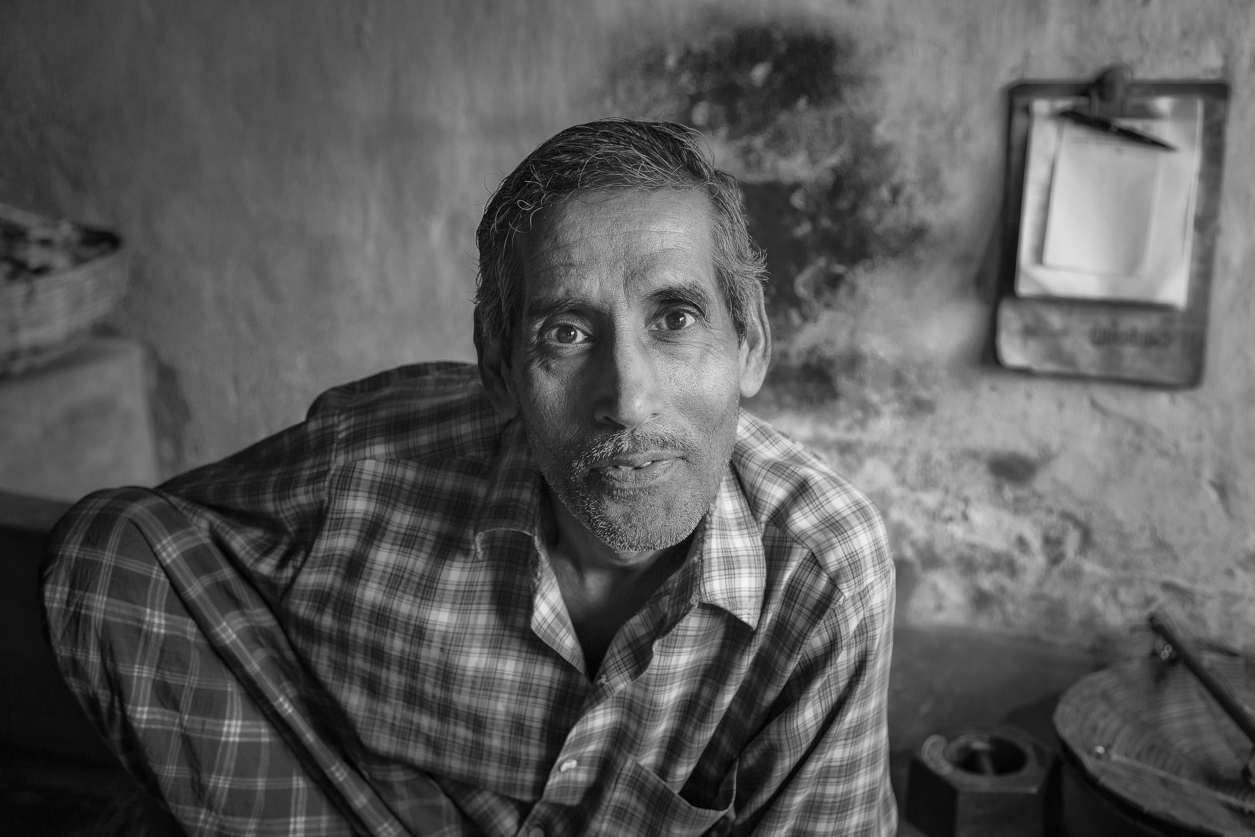 Portrait    of an interested soul in his shop in a local market in    Kolkata, India   .