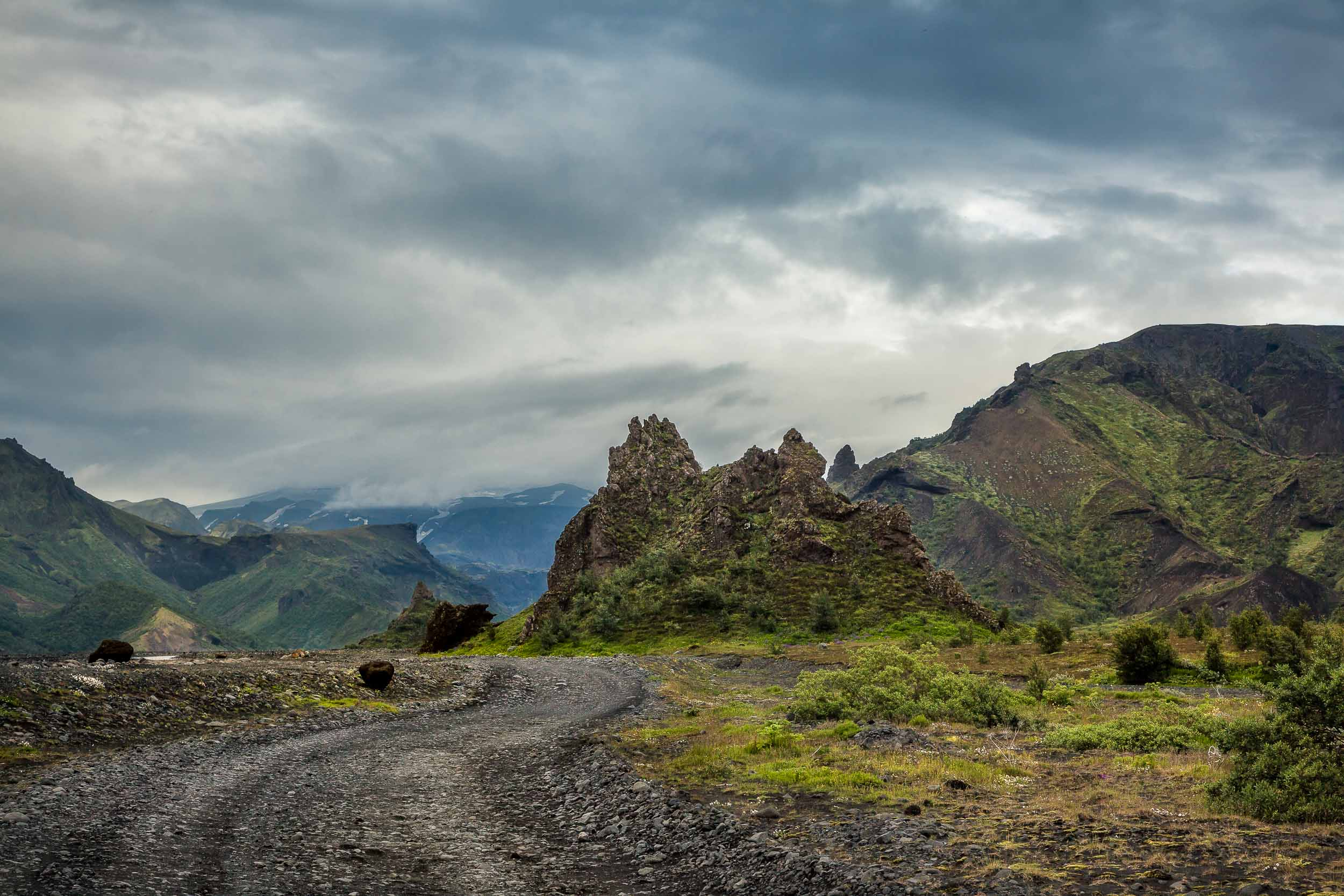 A    rough, stony road    marks my path through the    Highlands    region of Iceland.