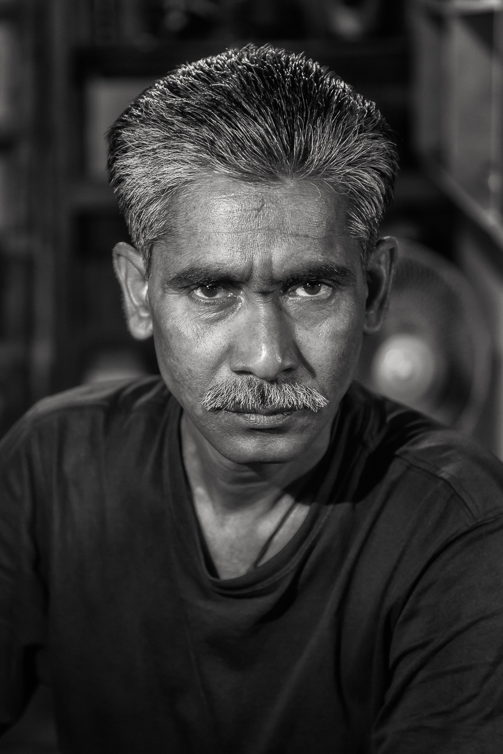 And    What is Wisdom   , Father? A    black and white portrait    of a    father figure    in    Kolkata, India   .