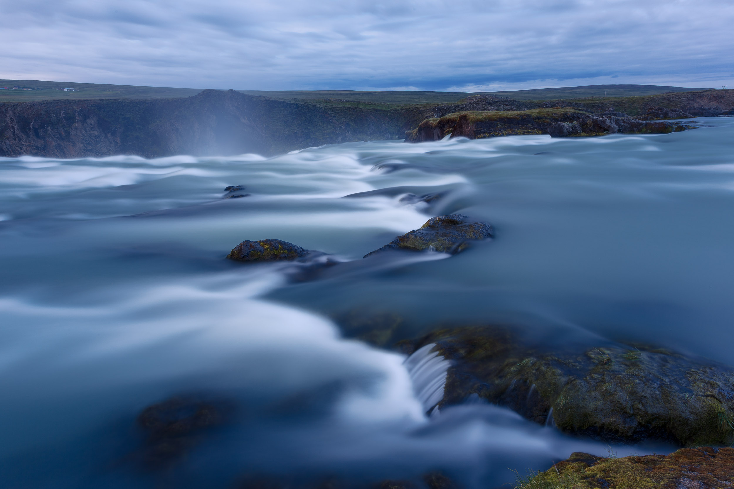 Water cascades over the    upper reaches    of    Godafoss   , the waterfall of the gods, in the north of    Iceland   .