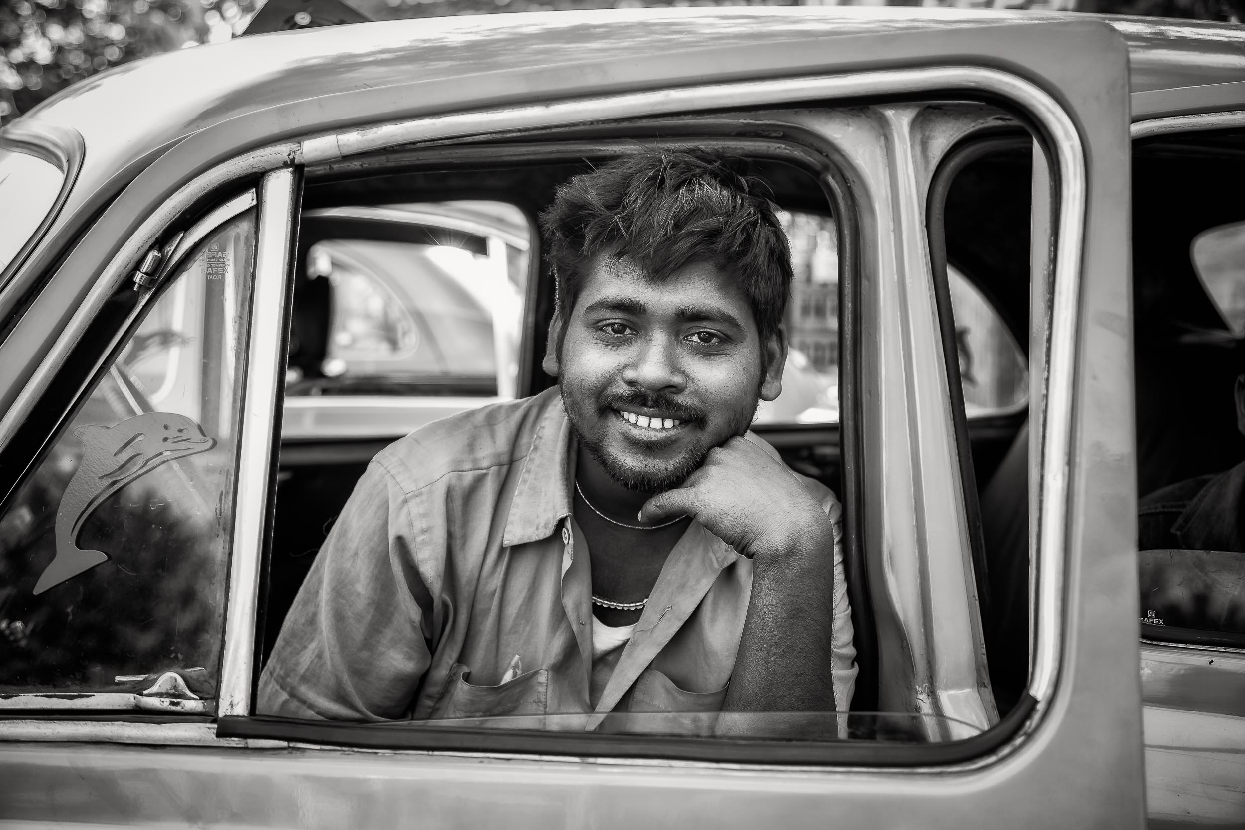 Environmental Portrait of a    taxi driver    at rest in the back streets of    Kolkata, India   .