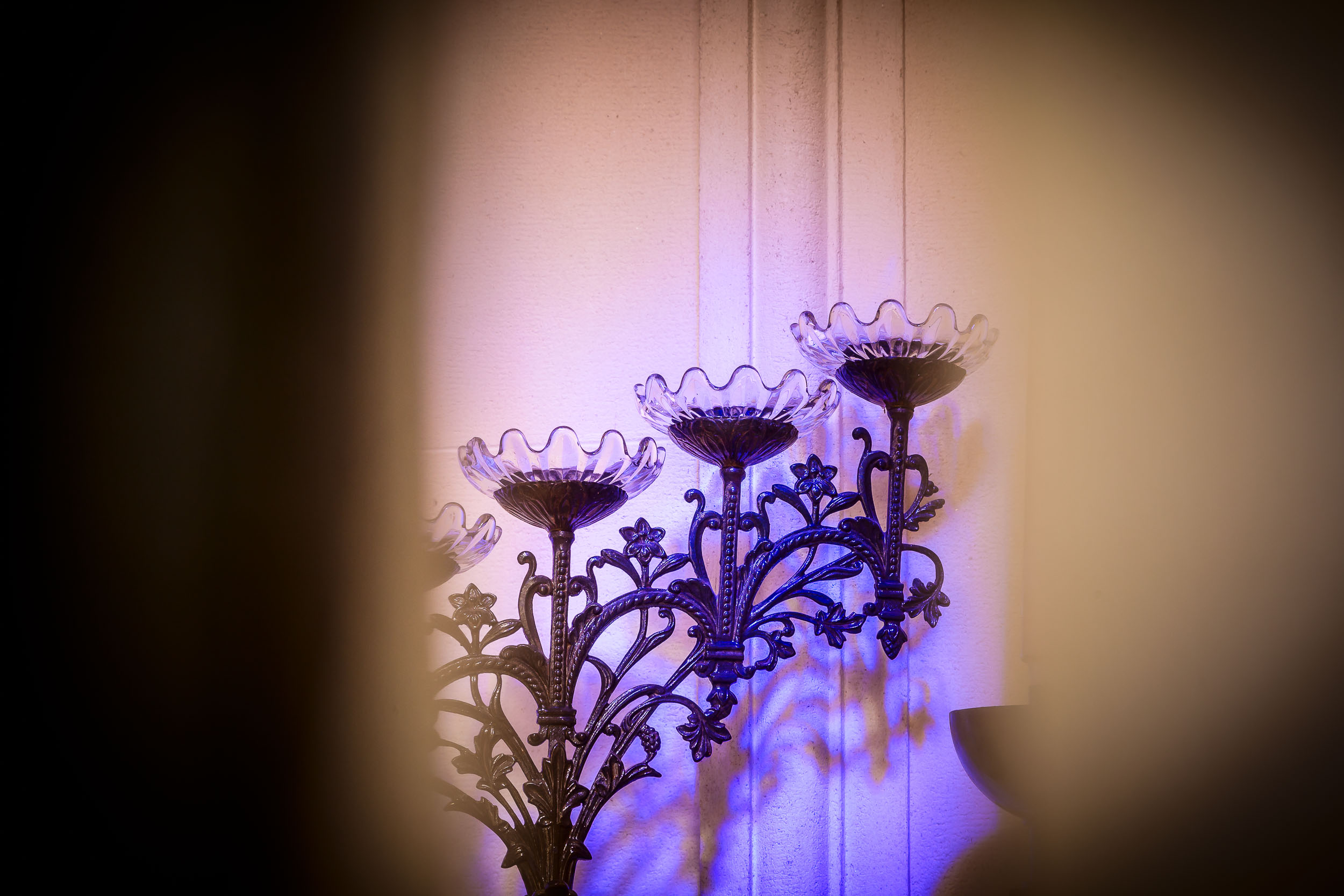 A colorful detail of a    candelabra    inside a    crypt    at    La Recoleta Cemetery    in    Buenos Aires, Argentina   .