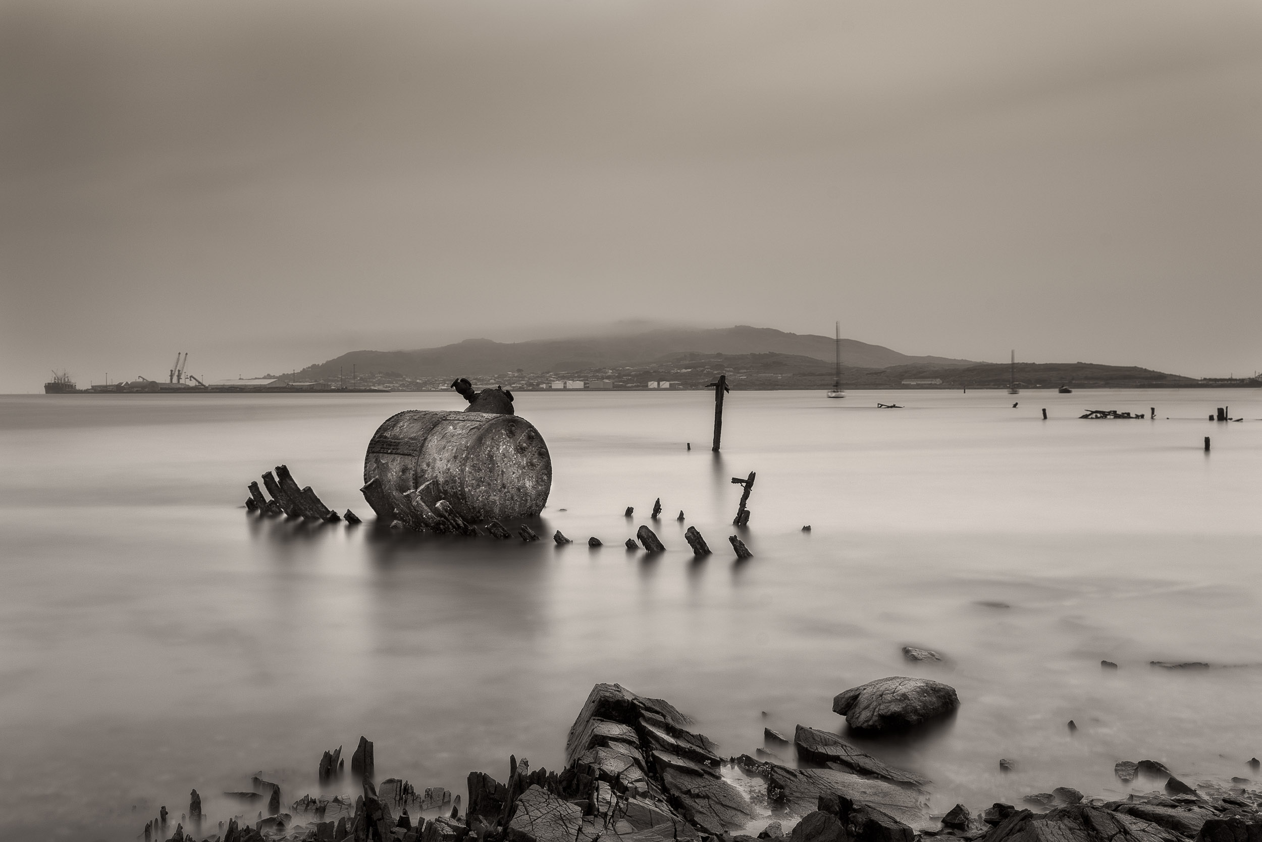 The remains of an    old ship    at    low tide    just outside of    Bluff   , right at the bottom of    New Zealand   .