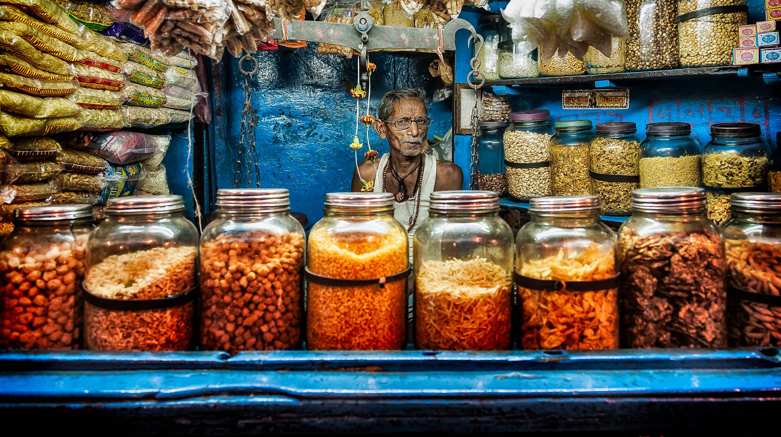 A    retailer   , amidst a    sea of color   , in his store in    Kolkata, India   .
