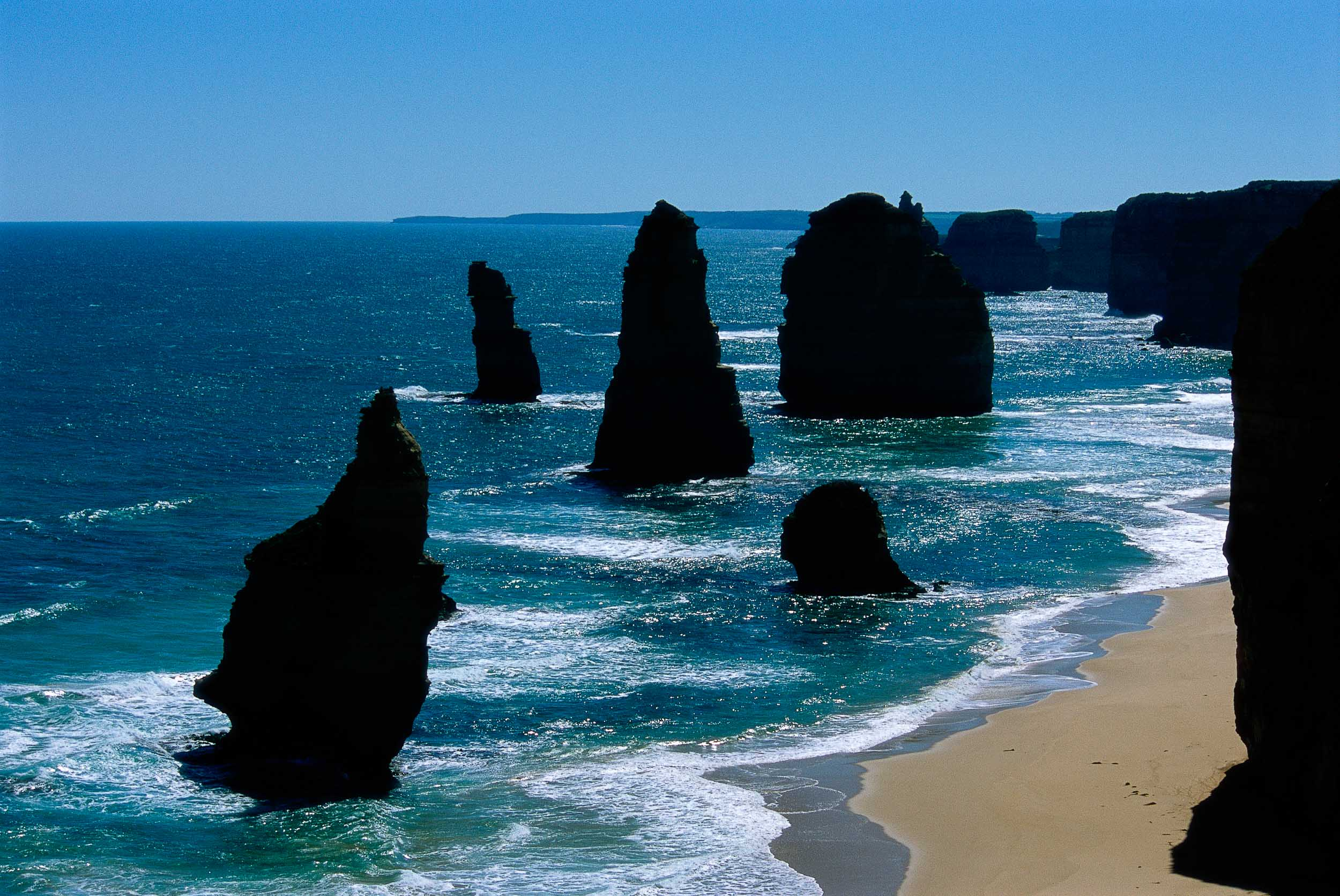 The iconic    Twelve Apostles   , in    silhouette   , along the    Great Ocean Road    in    Australia  .