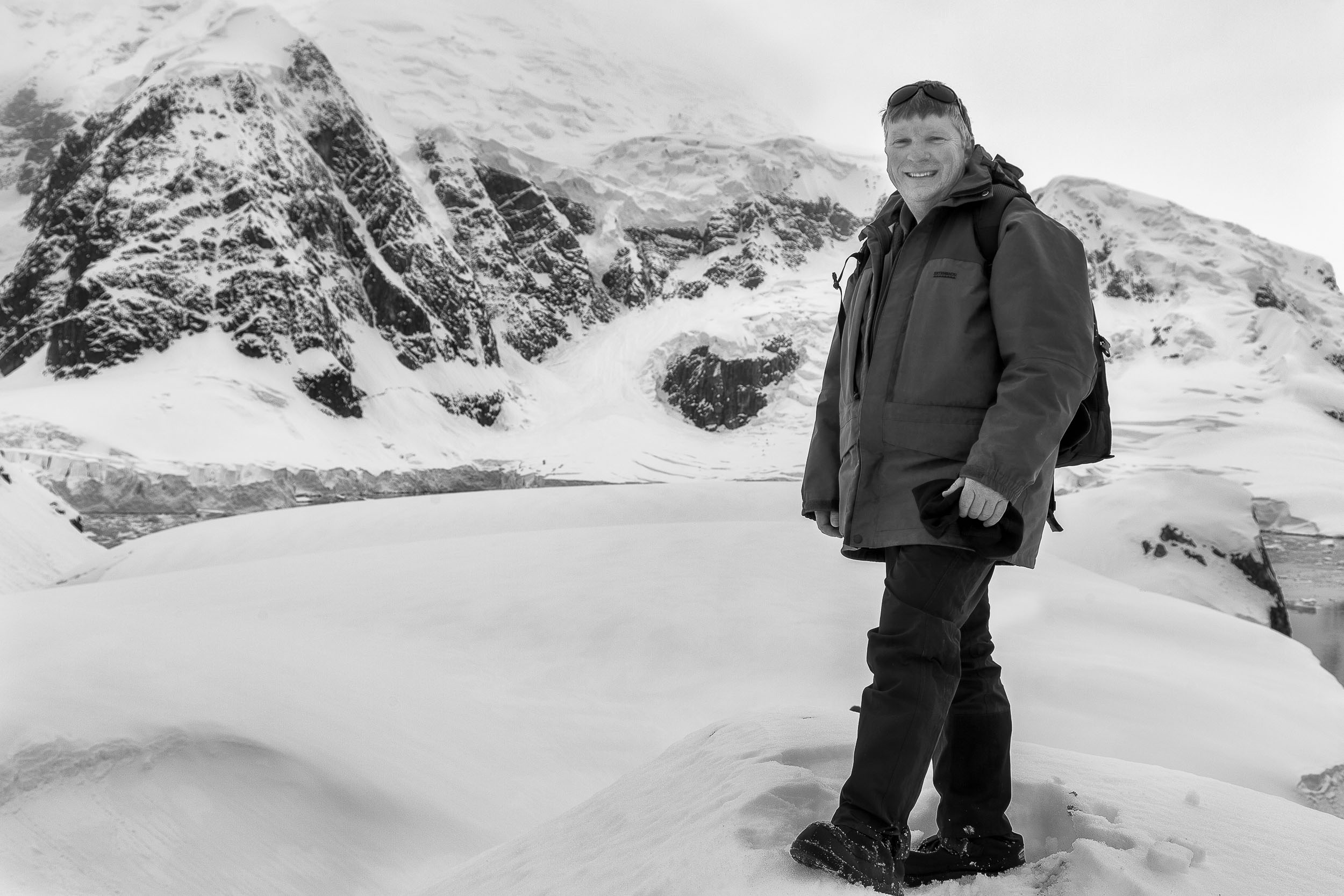 Glenn Guy   , the    Travel Photography Guru   , pictured high above the spectacular    Paradise Harbour    in    Antarctica   .
