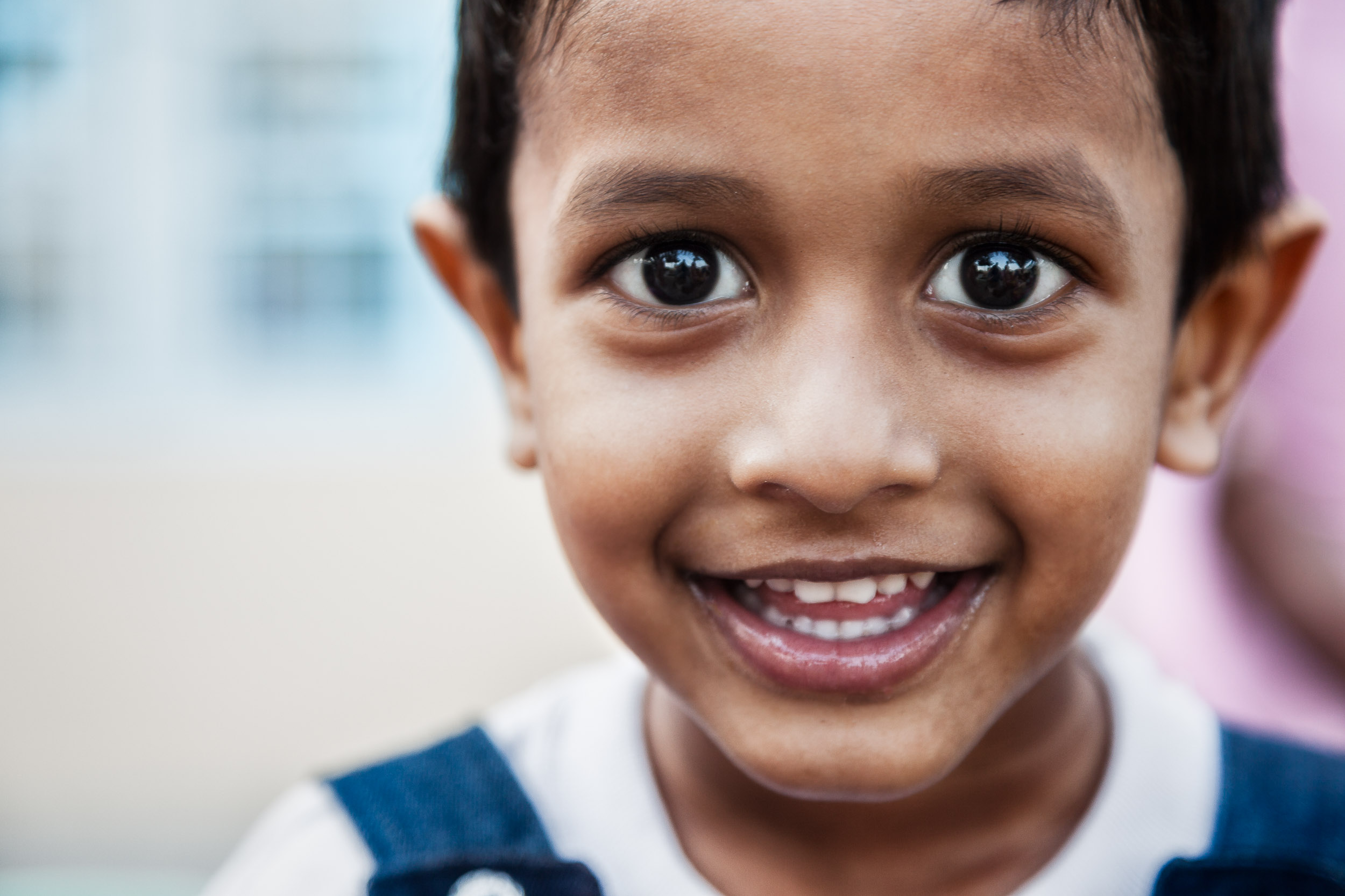 An expression of interest is alive in the eyes of this    young boy    on the outskirts of    Chennai    in Tamil Nadu,    India   .