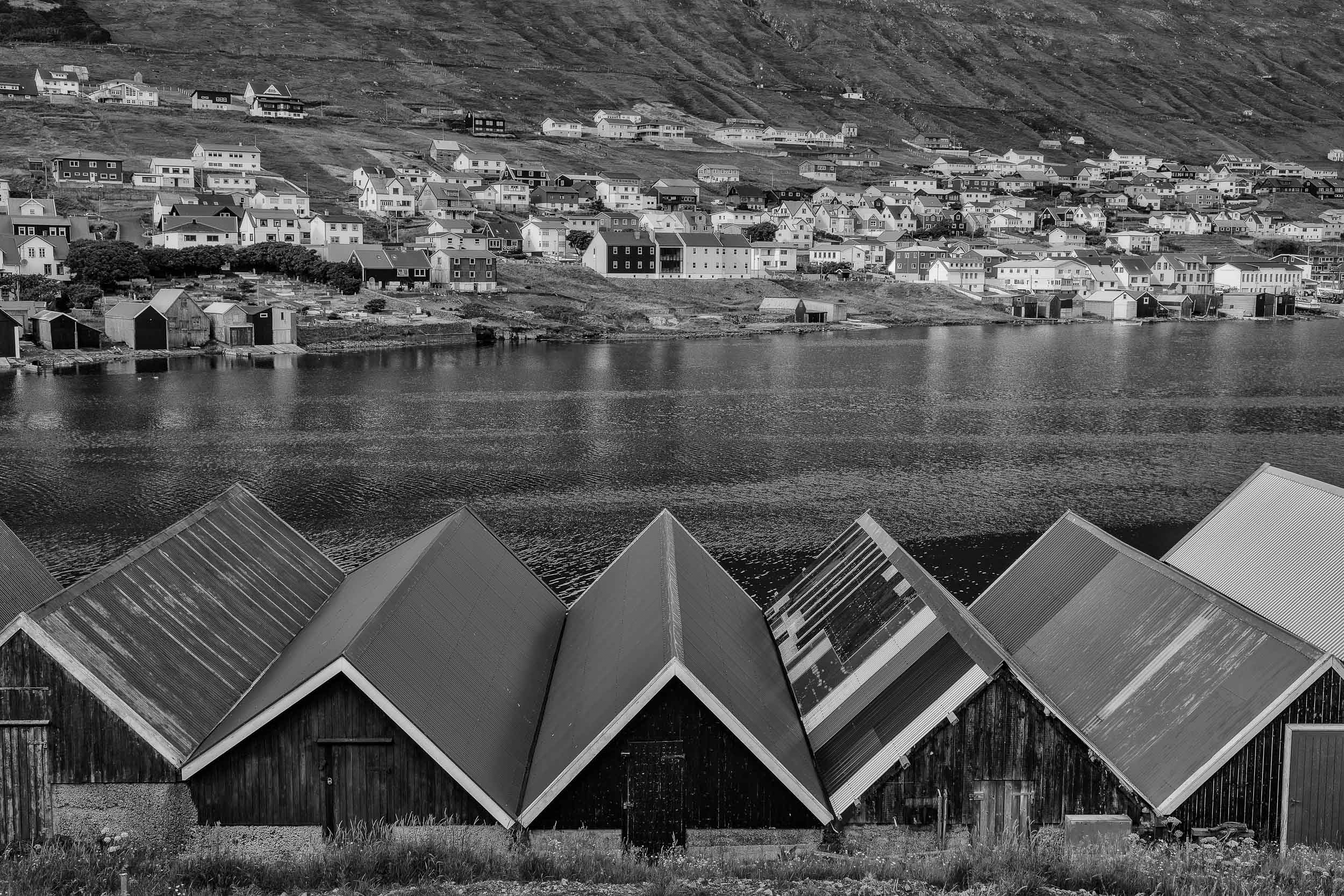 Boat houses and fjord in the    village of Vágur    on the island of    Suðuroy    in the    Faroe Islands   .