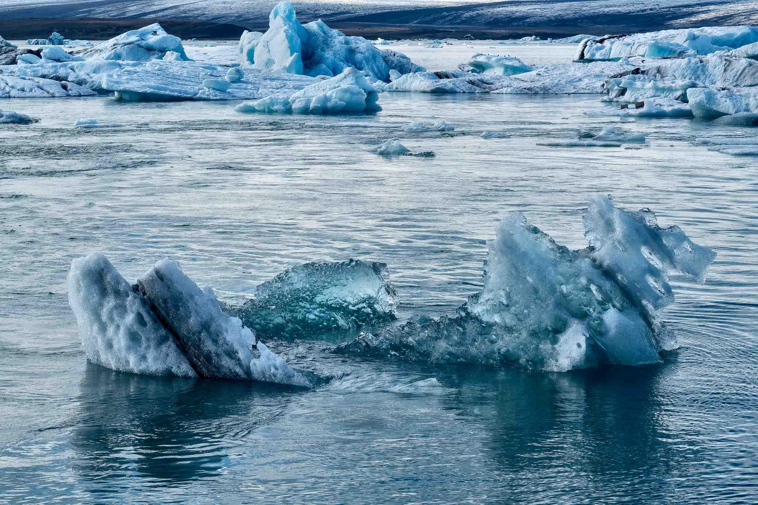 Cold, blue light illuminating    icebergs    at the    Jökulsárlón Glacier Lagoon    in    Iceland   .