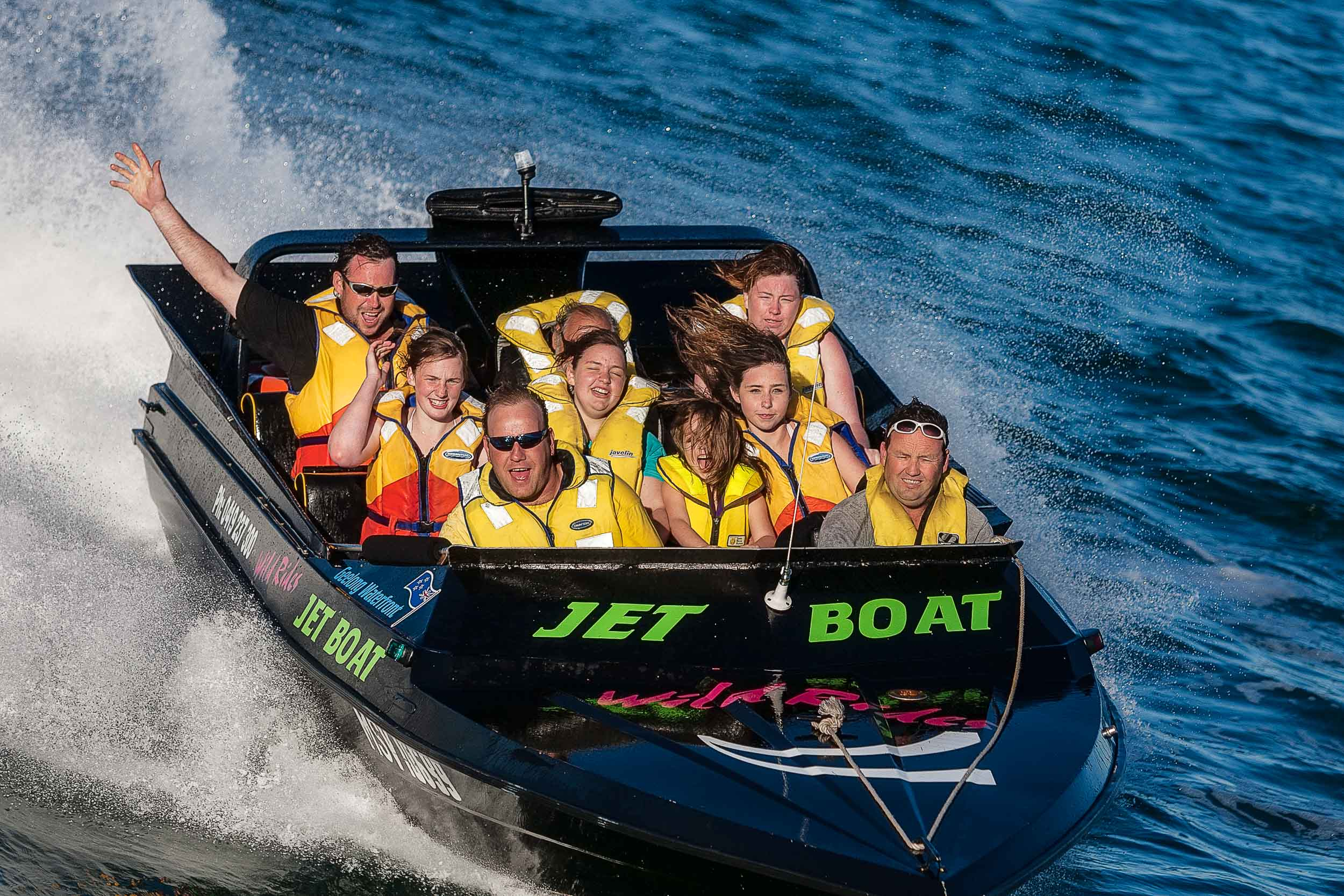 Excitement is evident on the faces of passengers as they    jet boat    around the harbour in    Geelong, Australia   .