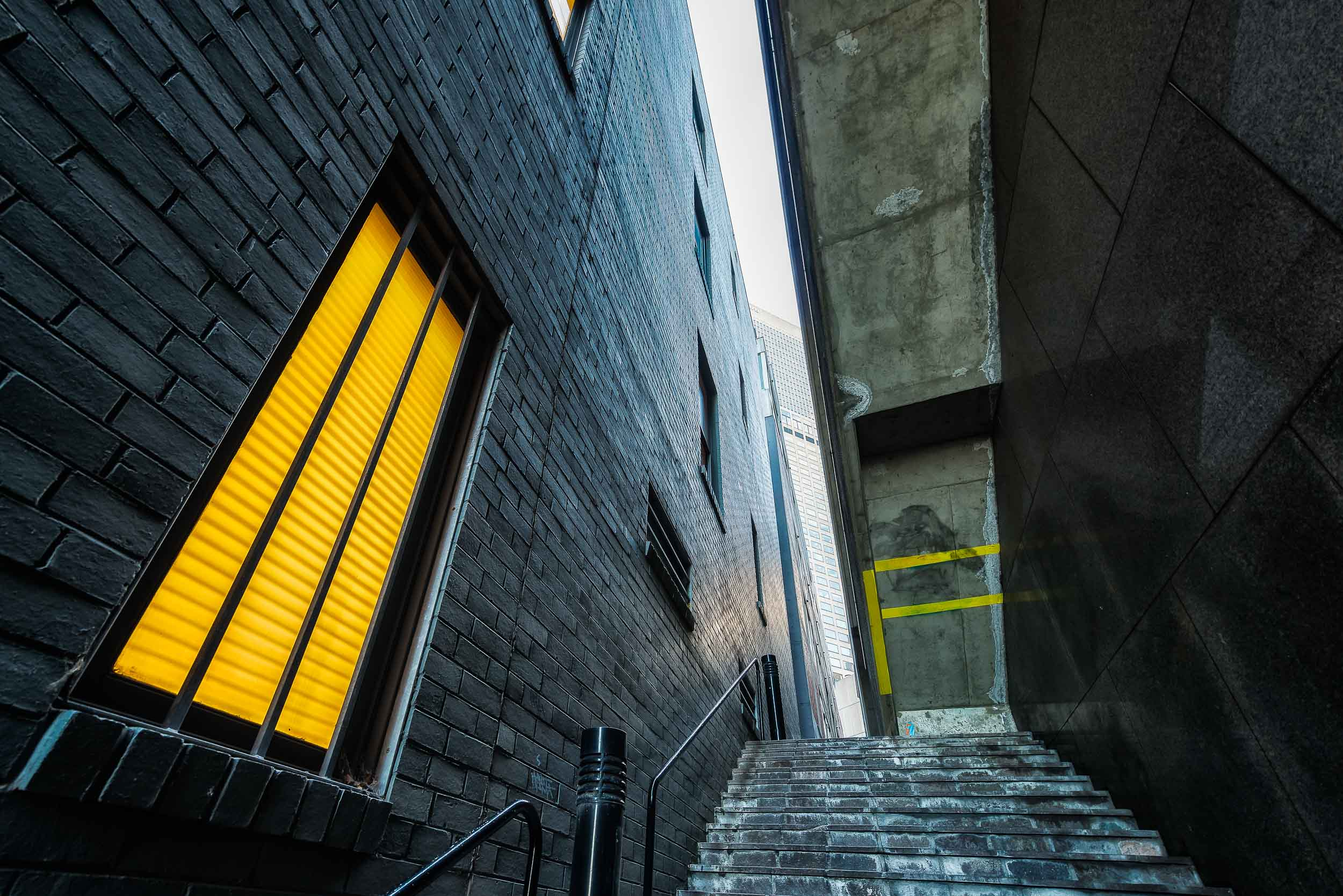 A    steep staircase    leads the visitor through a    narrow alleyway    in the    City of Melbourne, Australia   .