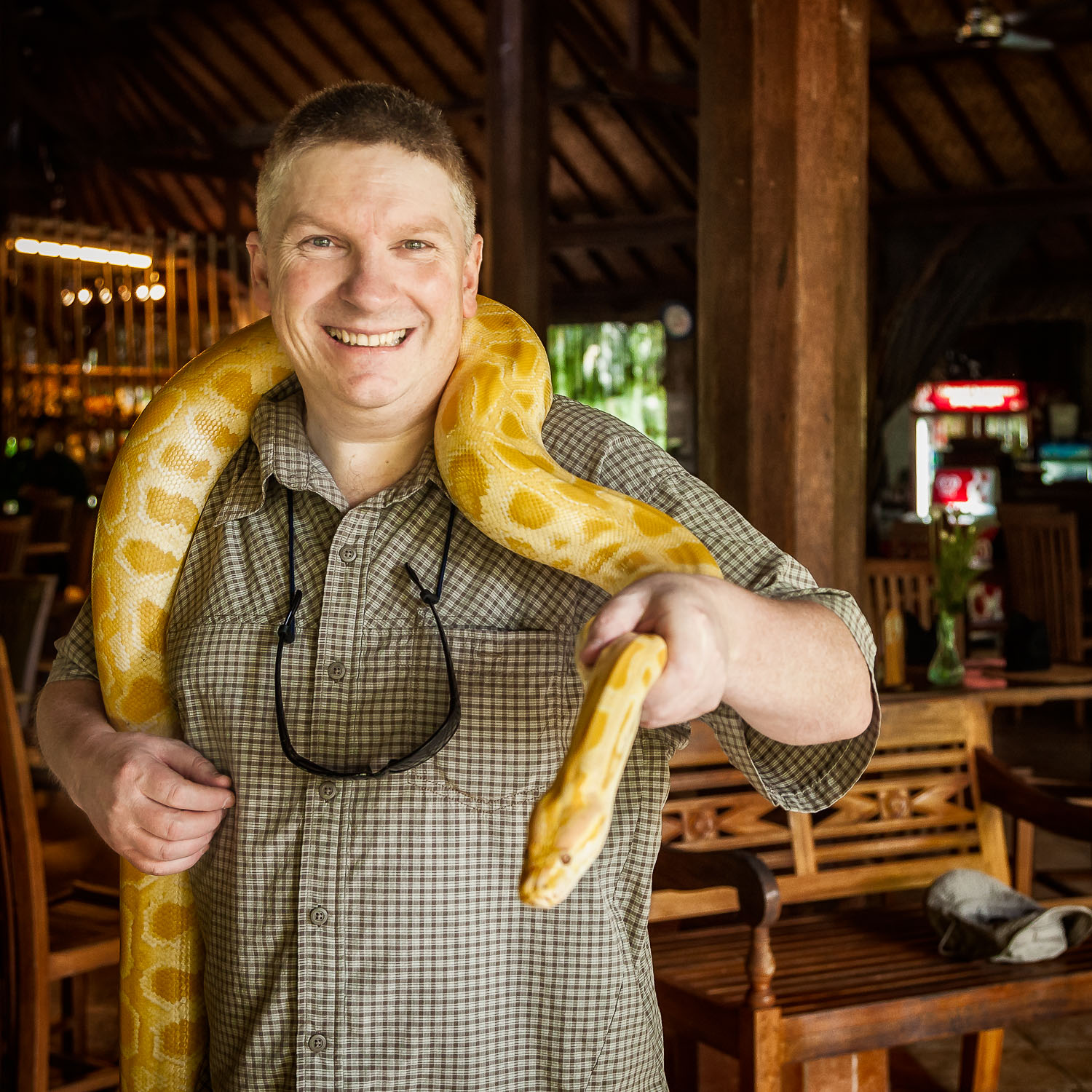 Glenn Guy   , photographer and owner of the    Travel Photography Guru    website and blog, holding a    python    at the    Bali Zoo    near Ubud in    Indonesia   .