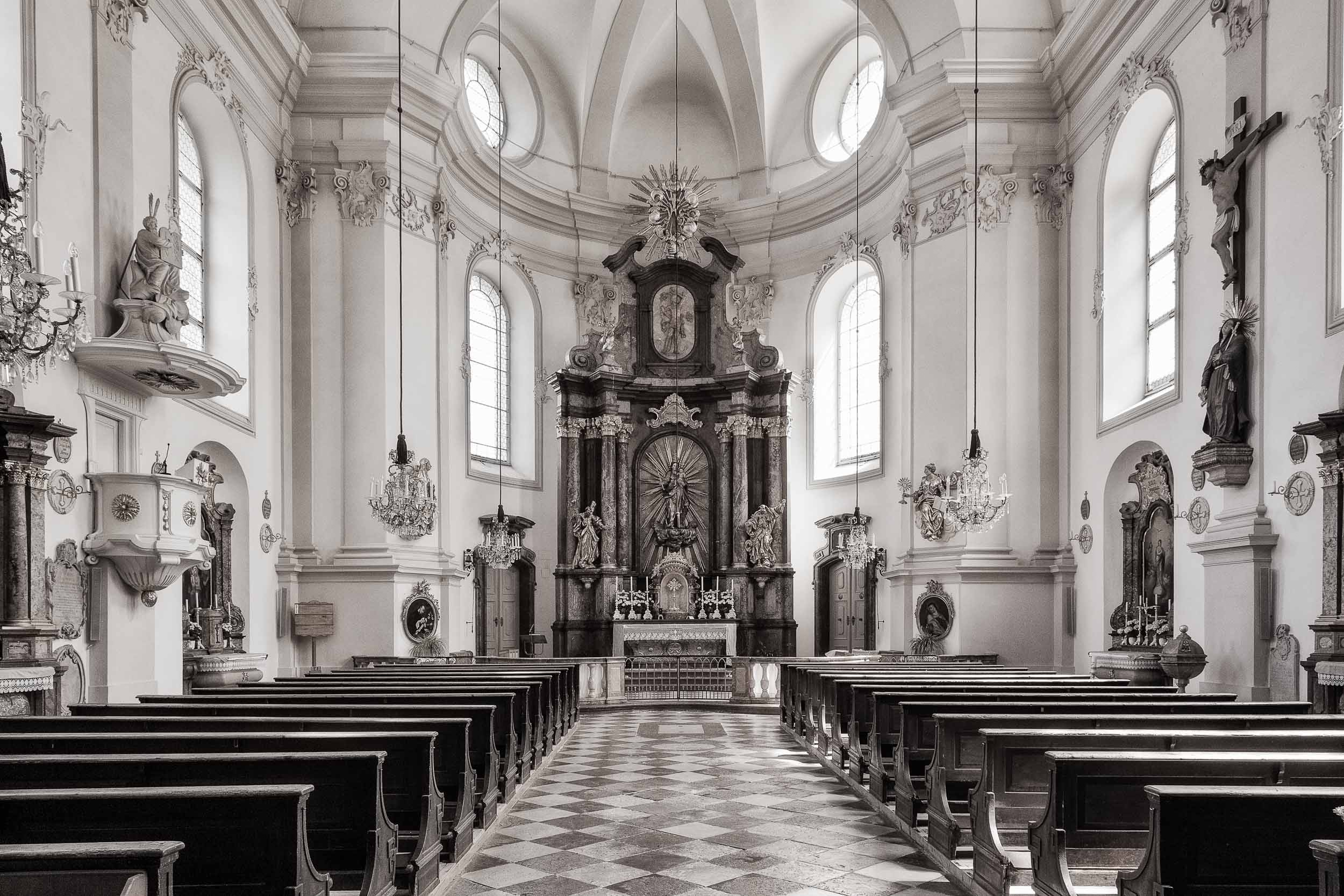 An interior    warm tone black and white    view of the beautiful    St. Sebastian's Church    in    Salzburg, Austria   .