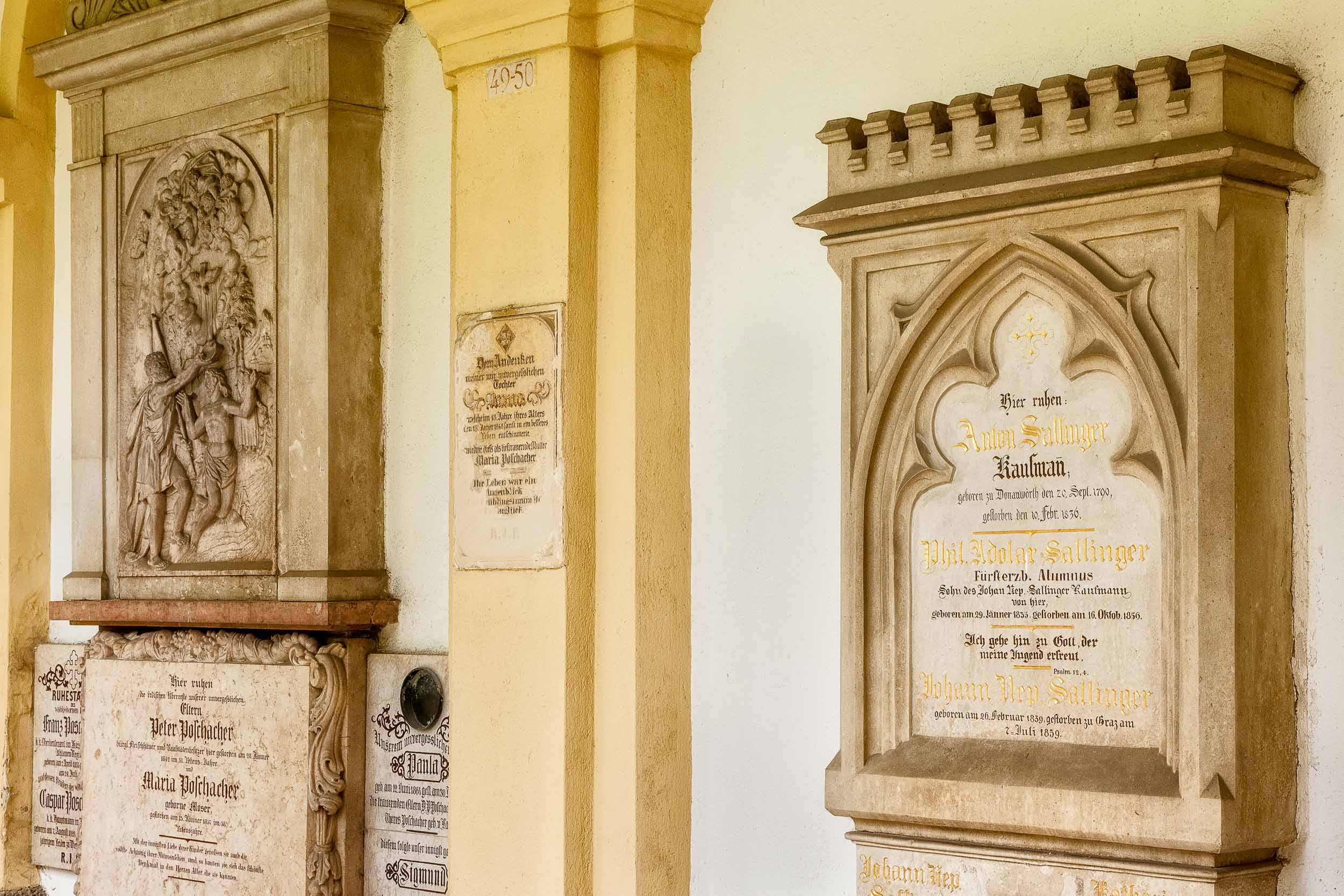 Headstones and plaques    along one of the    four arcades    surroudning the    graveyard    at    St. Sebastian's Cemetery    in    Salzburg, Austria   .