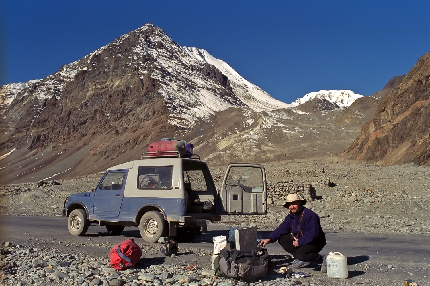 Glenn Guy   , the    Travel Photography Guru   , unpacking the jeep prior to another automotive repair on the road to    Pangong Tso, Ladakh   , India back in the early 90's.