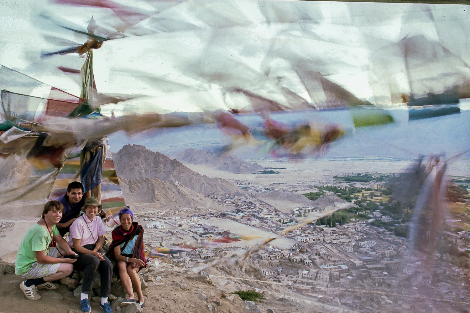 The Travel Photography Guru,    Glenn Guy   , and friends surrounded by    prayer flags    over looking    Leh, Ladakh   .