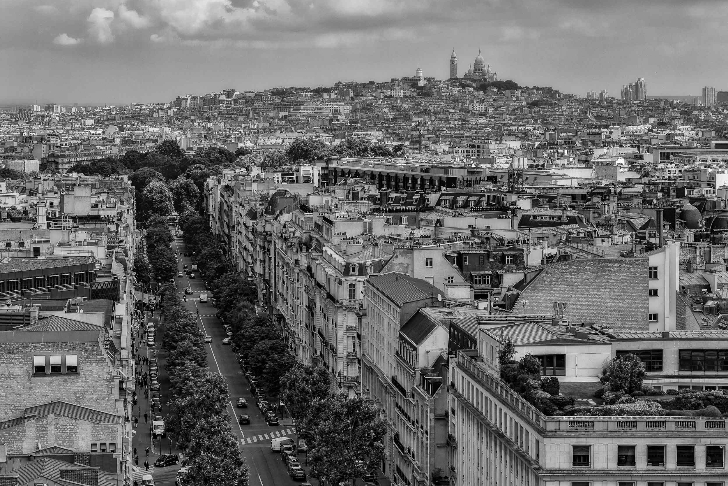 A rooftop view towards the    Sacre Coeur Basilica    on    Montmarte    in    Paris    from atop the    Arc de Triomphe   .